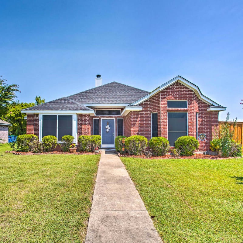 brick home with green lawn in Forth Worth, Texas