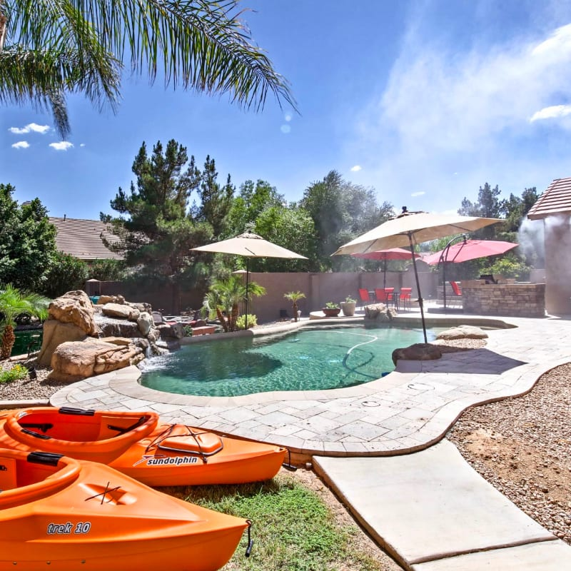 Vacation rental home in Scottsdale, Arizona with a pool and kayaks in the yard