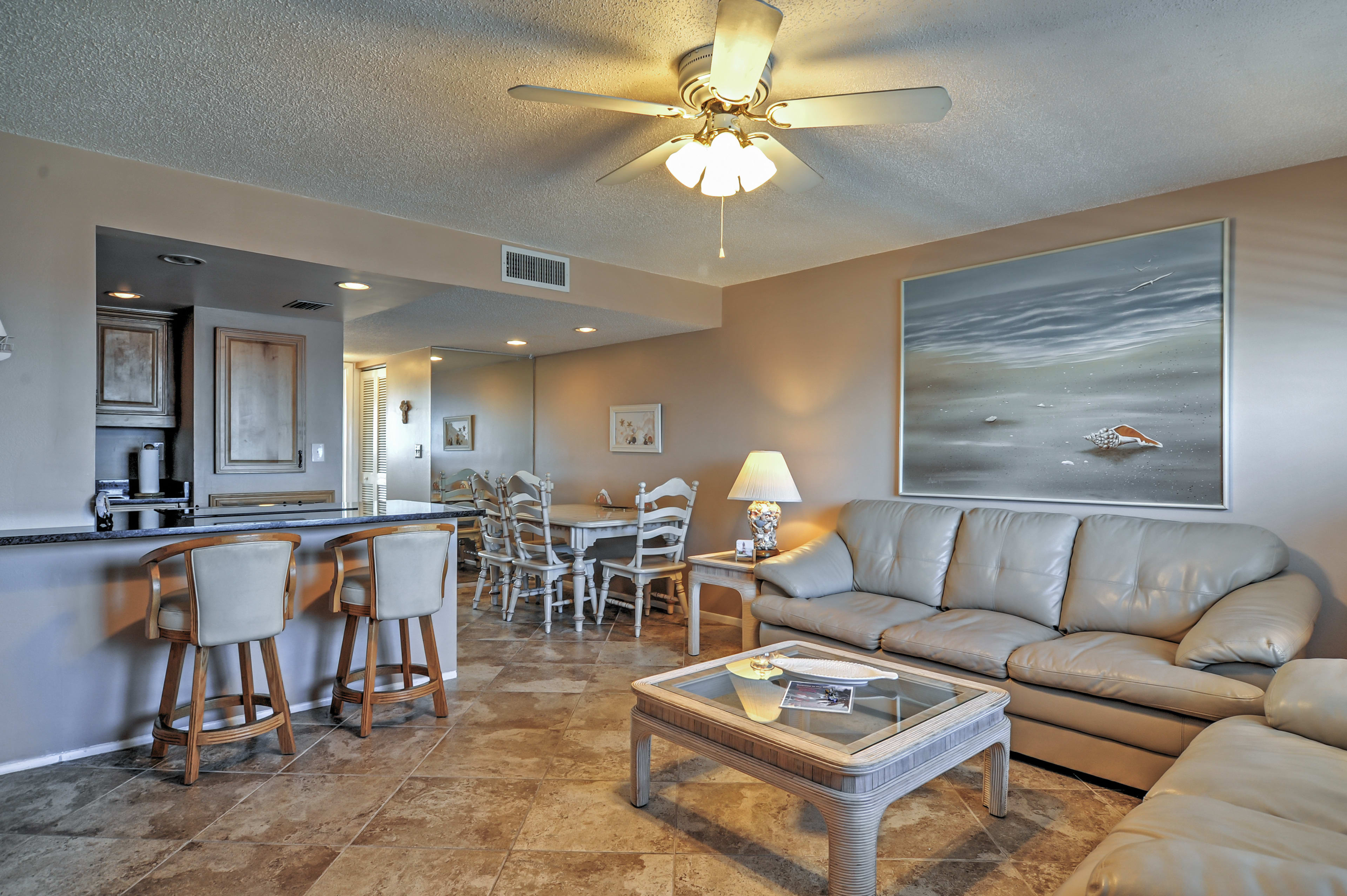 Cool off in the beachy condo.