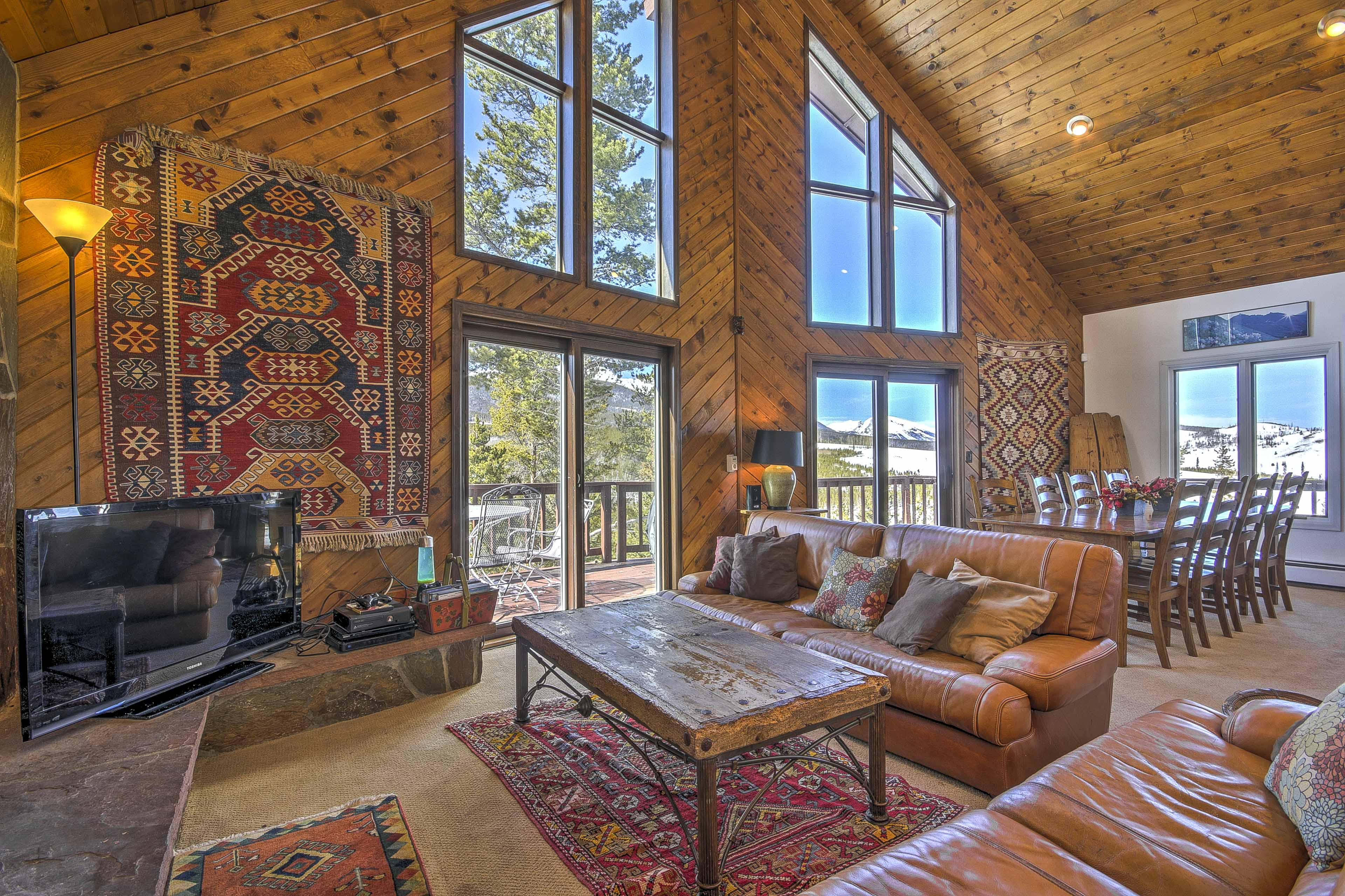 Soaring vaulted ceilings and floor-to-ceiling windows await.