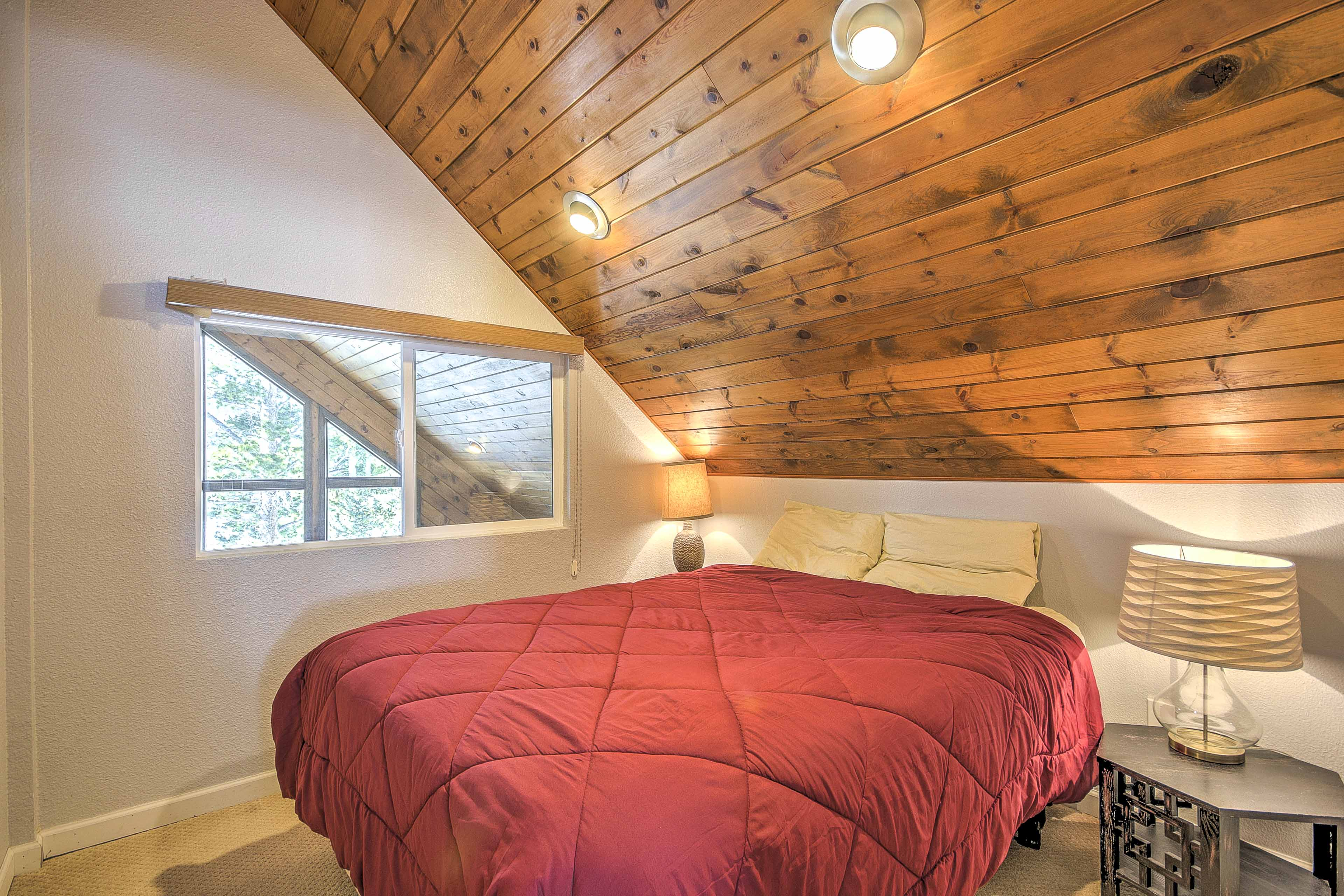 Vaulted ceilings elevate this space.