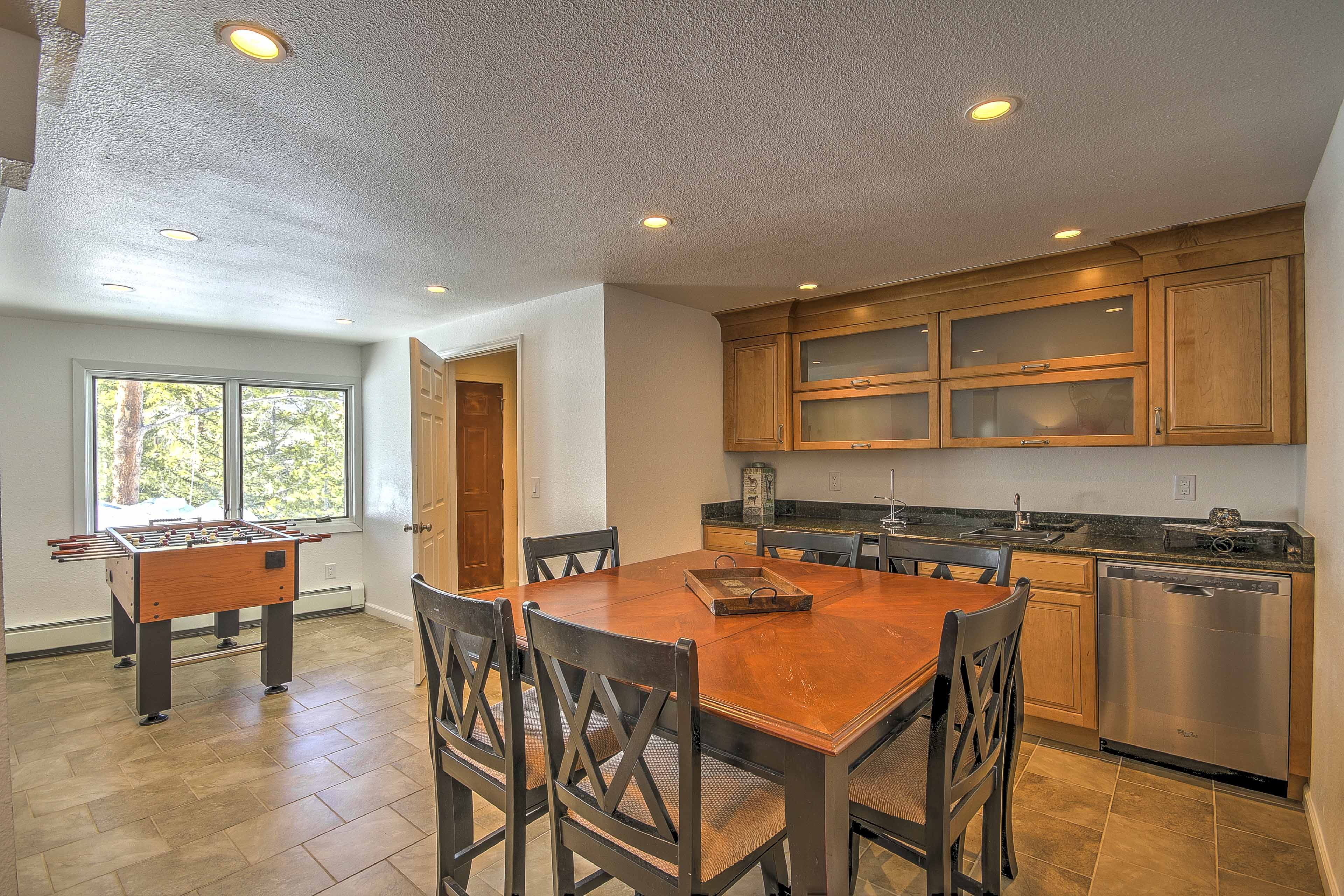 The second living area even features a kitchenette and even a foosball table!