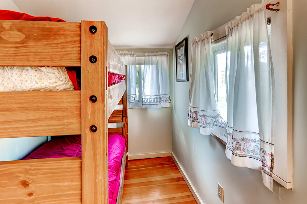You'll find a twin-over-twin bunk bed in this room.