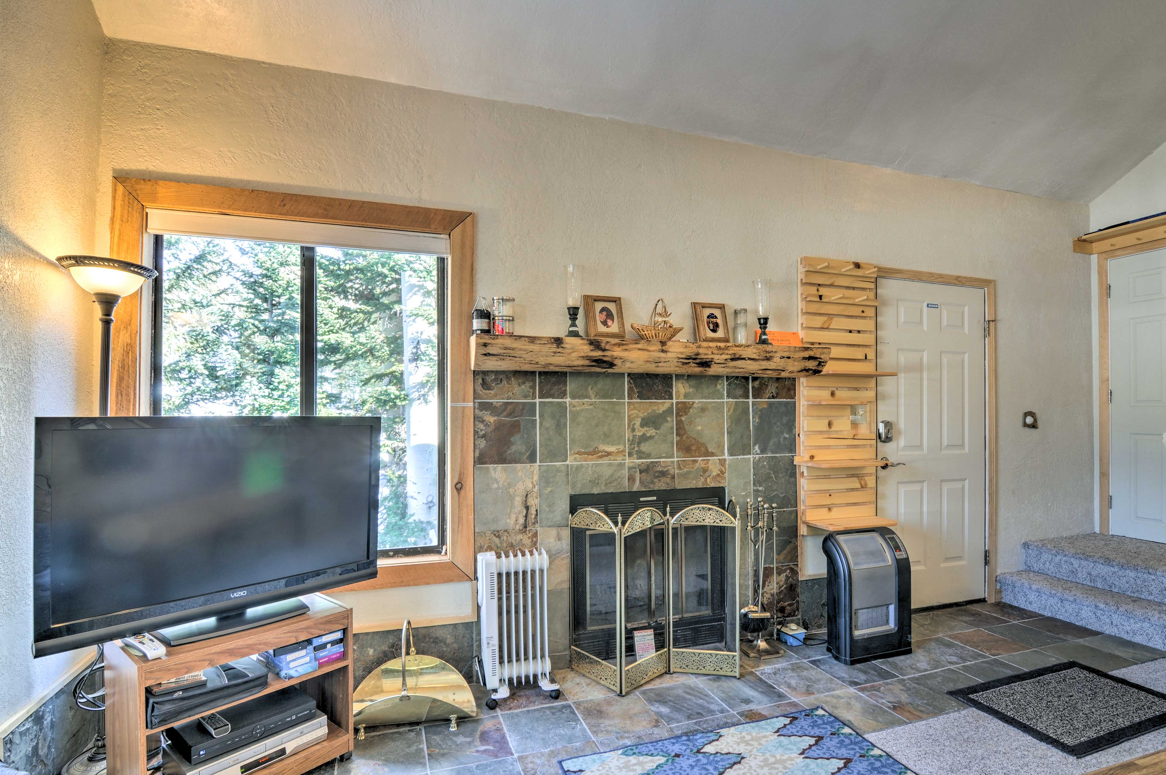 Watch your favorite shows on the flat-screen TV while you stoke the fire.