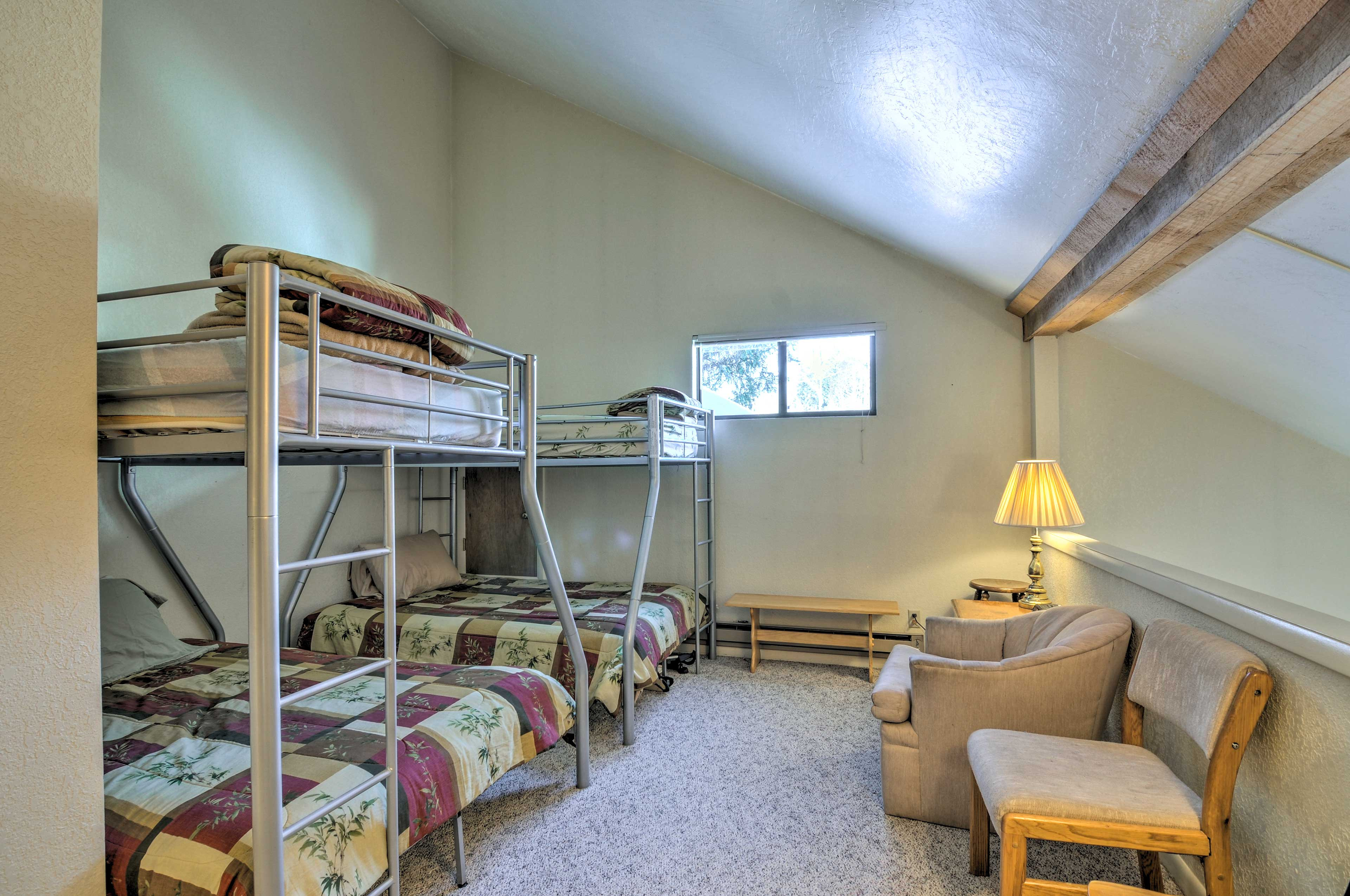 The second bedroom is located upstairs.