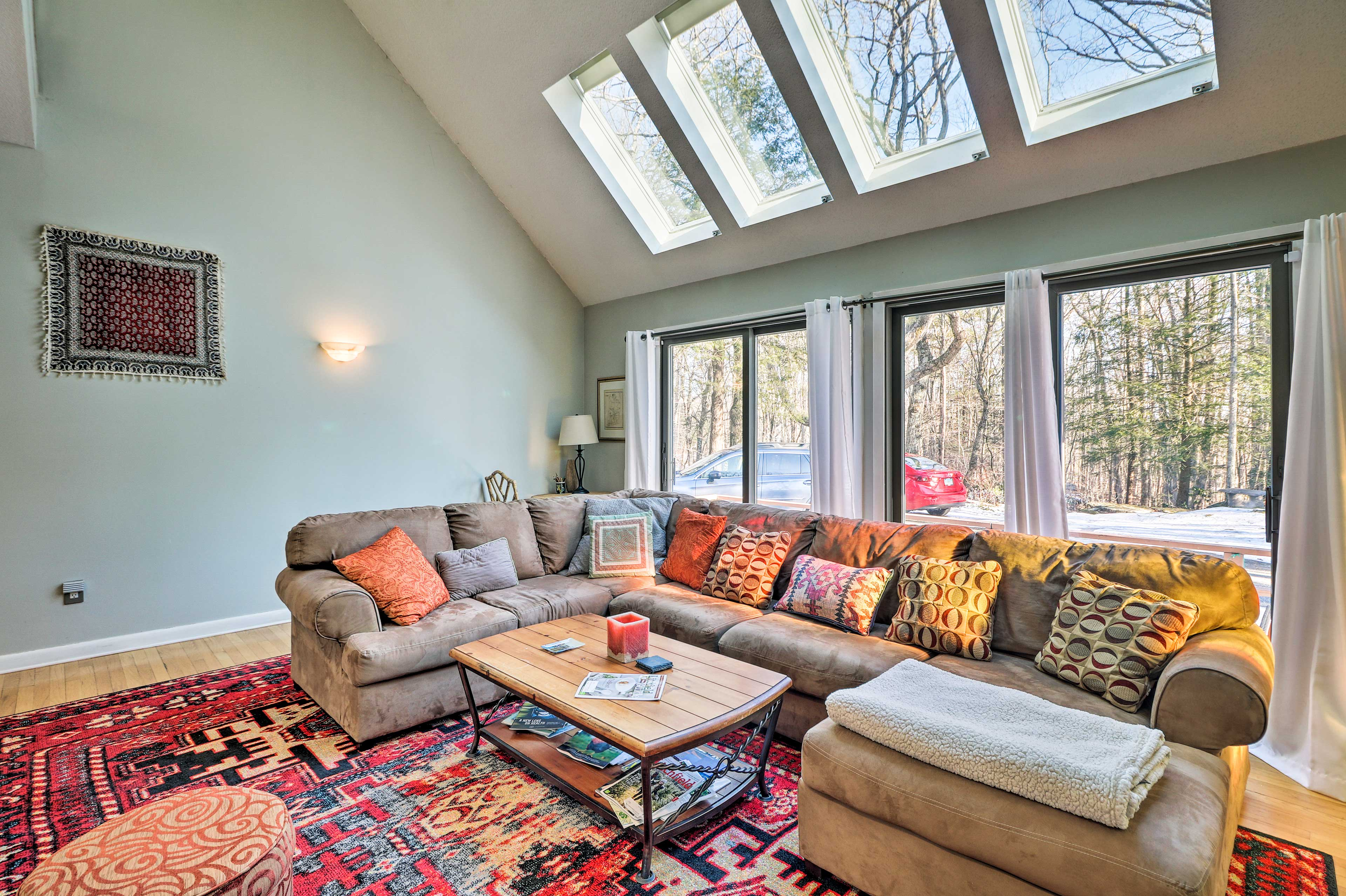 Natural light fills the space through the large windows and skylights.