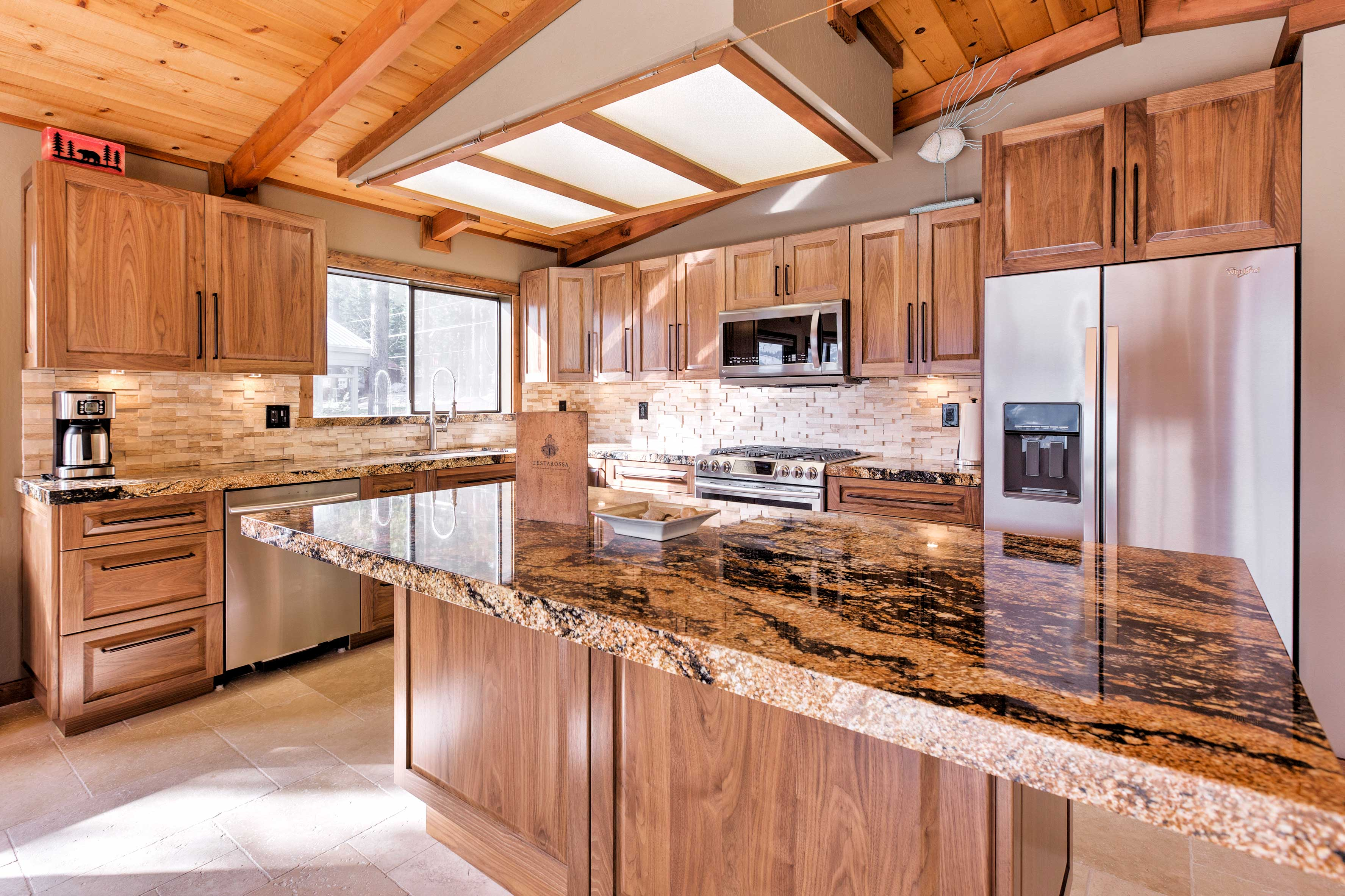 The fully equipped kitchen has granite counters and stainless steel appliances!