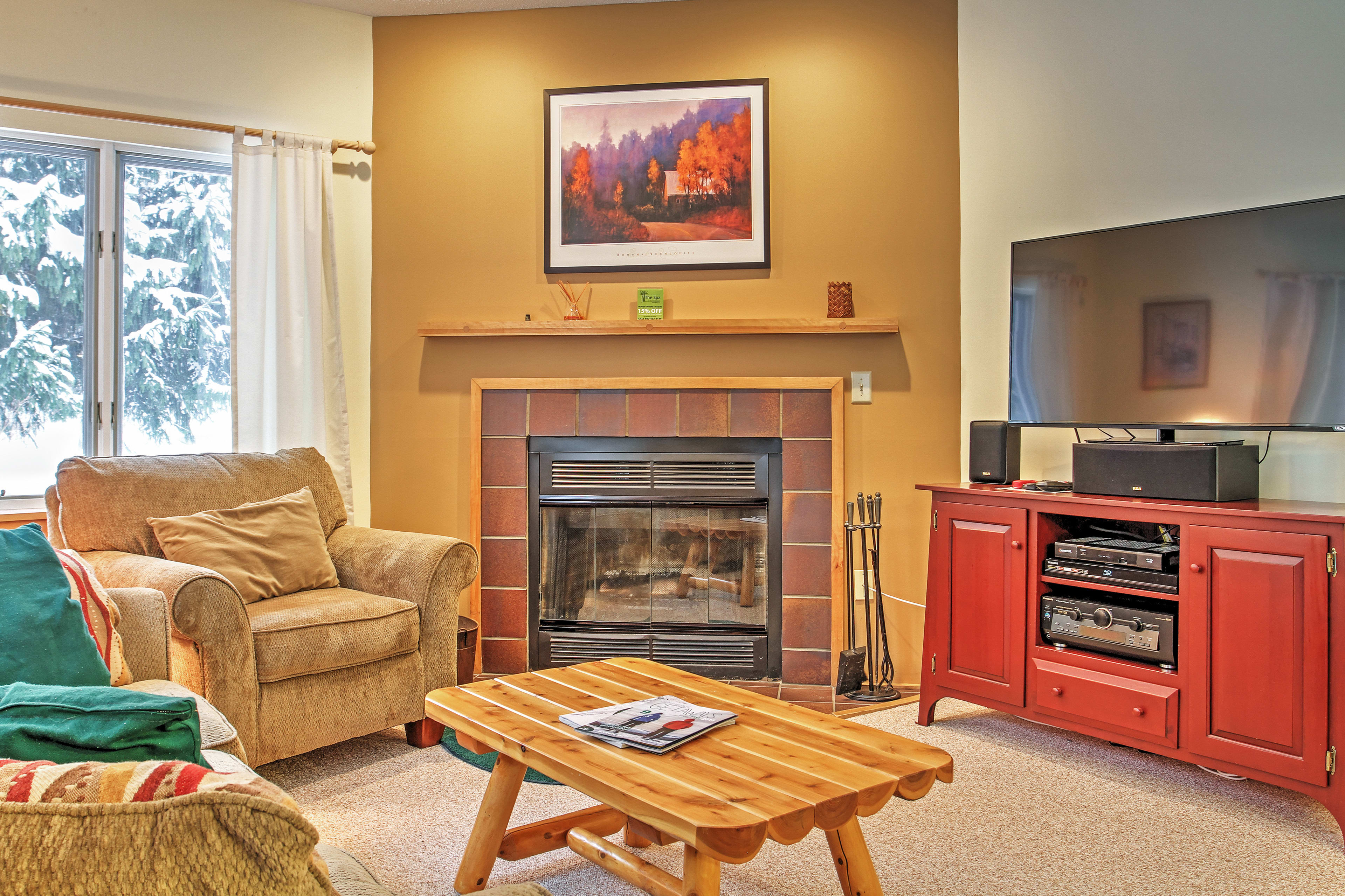 Watch a show on the HDTV with HBO access near the wood-burning fireplace.