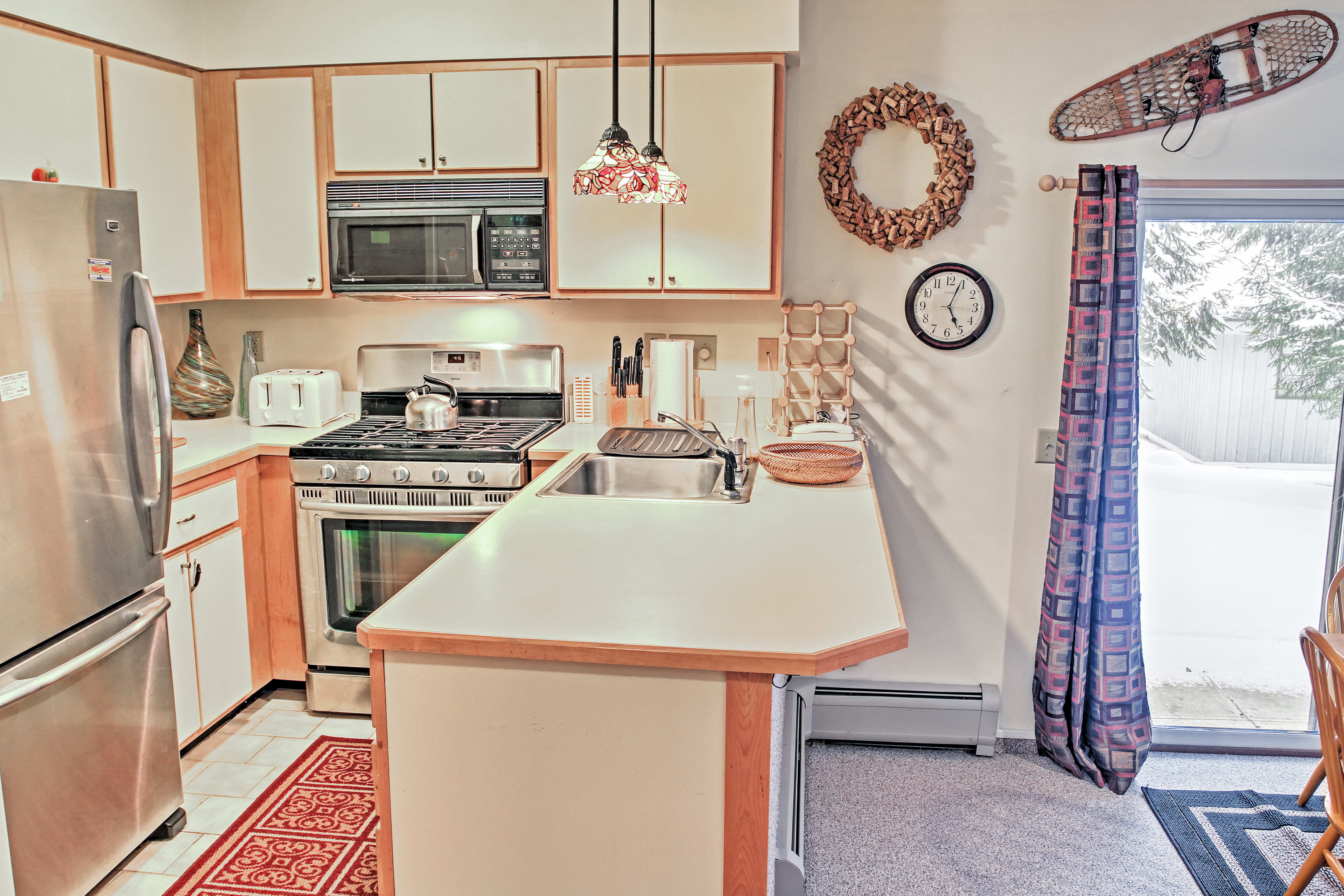 This kitchen comes fully equipped with updated, stainless steel appliances.