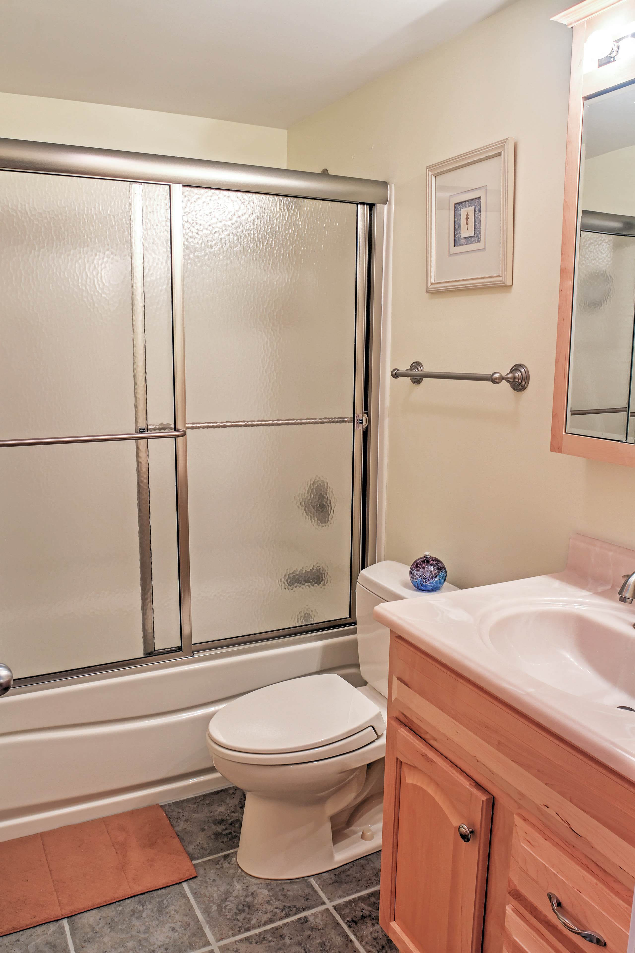 A second full bathroom provides additional privacy.
