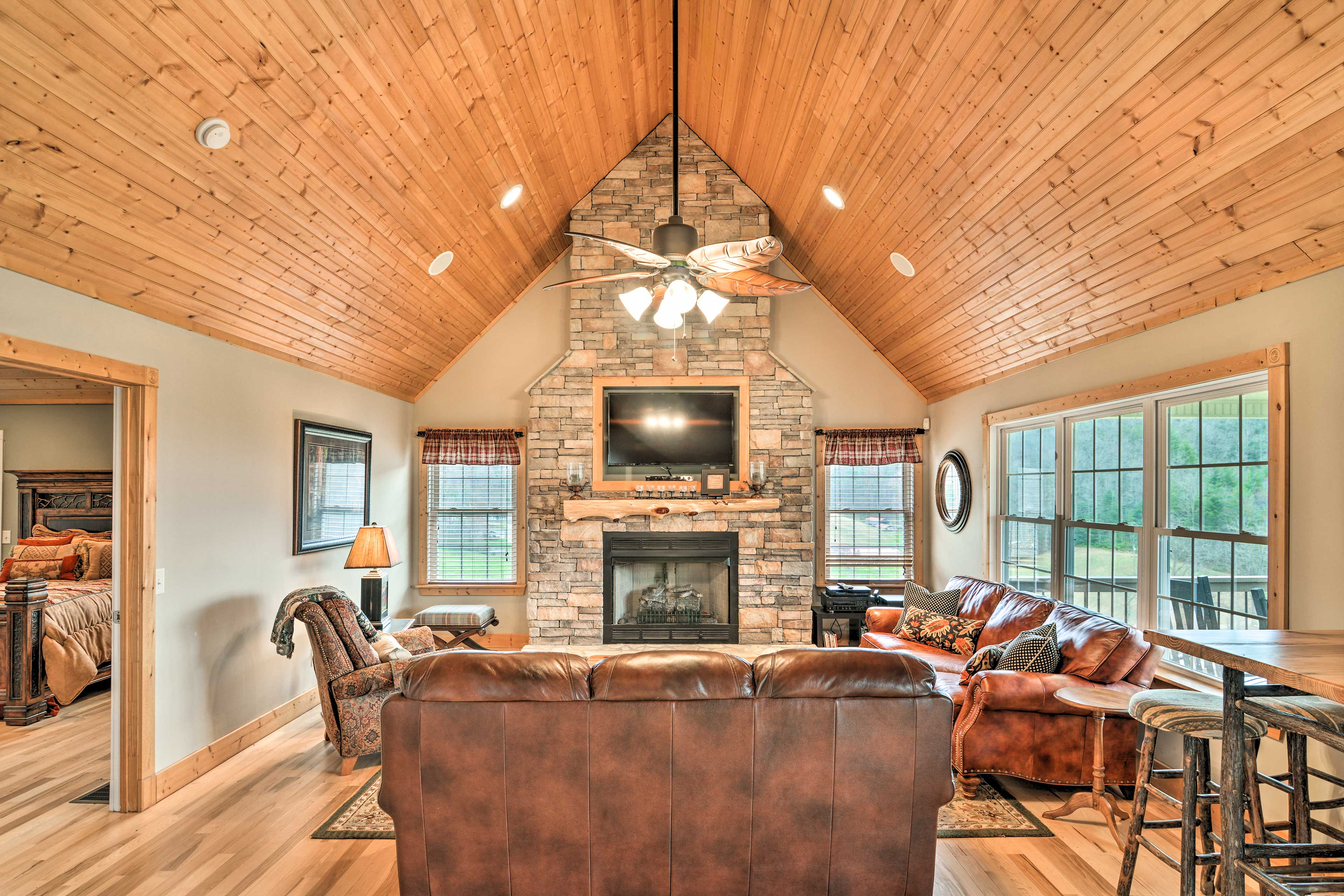 The gorgeous living room features cathedral ceilings & tall fireplace.