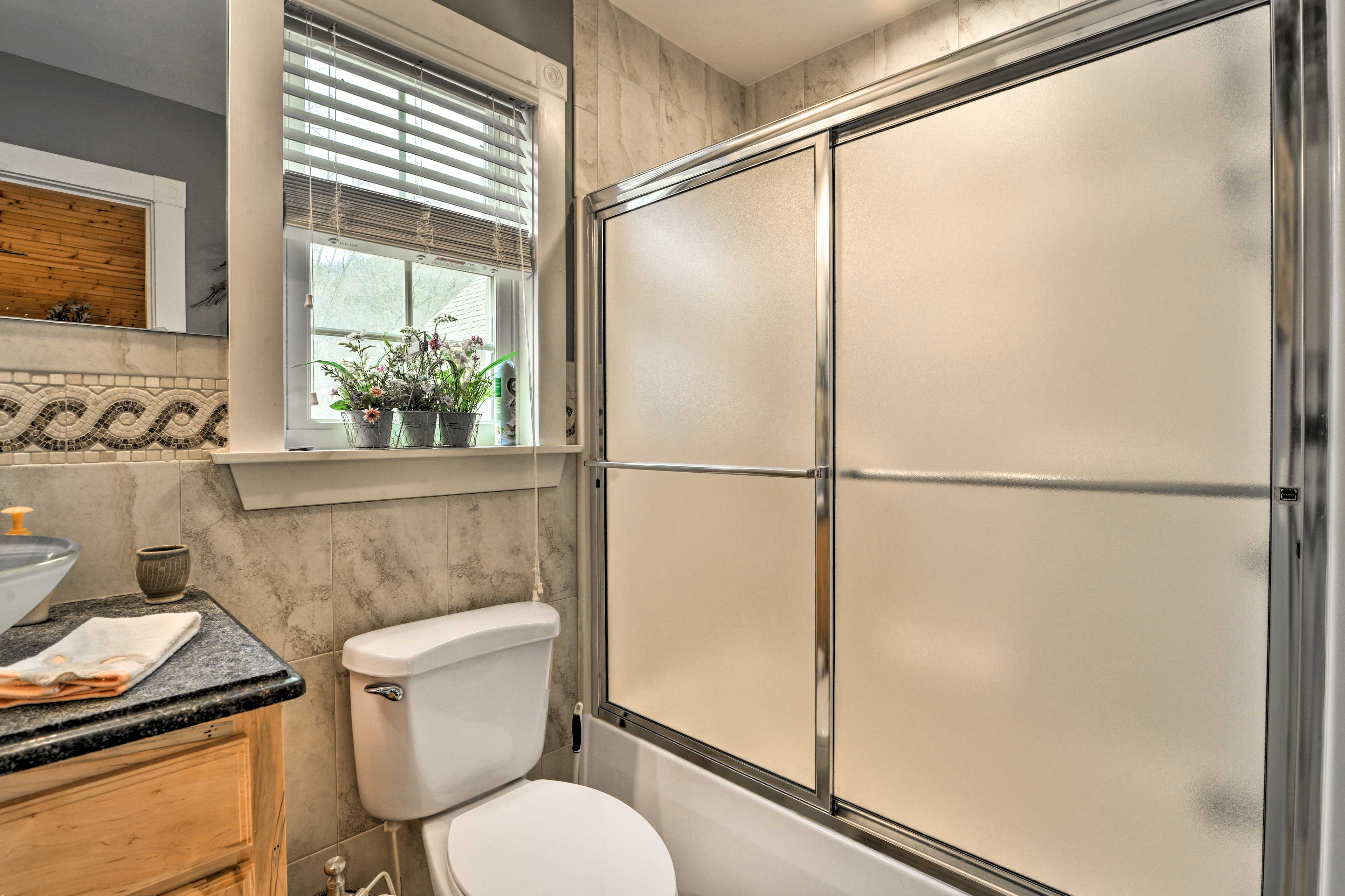 The second bathroom has a shower/tub combo.