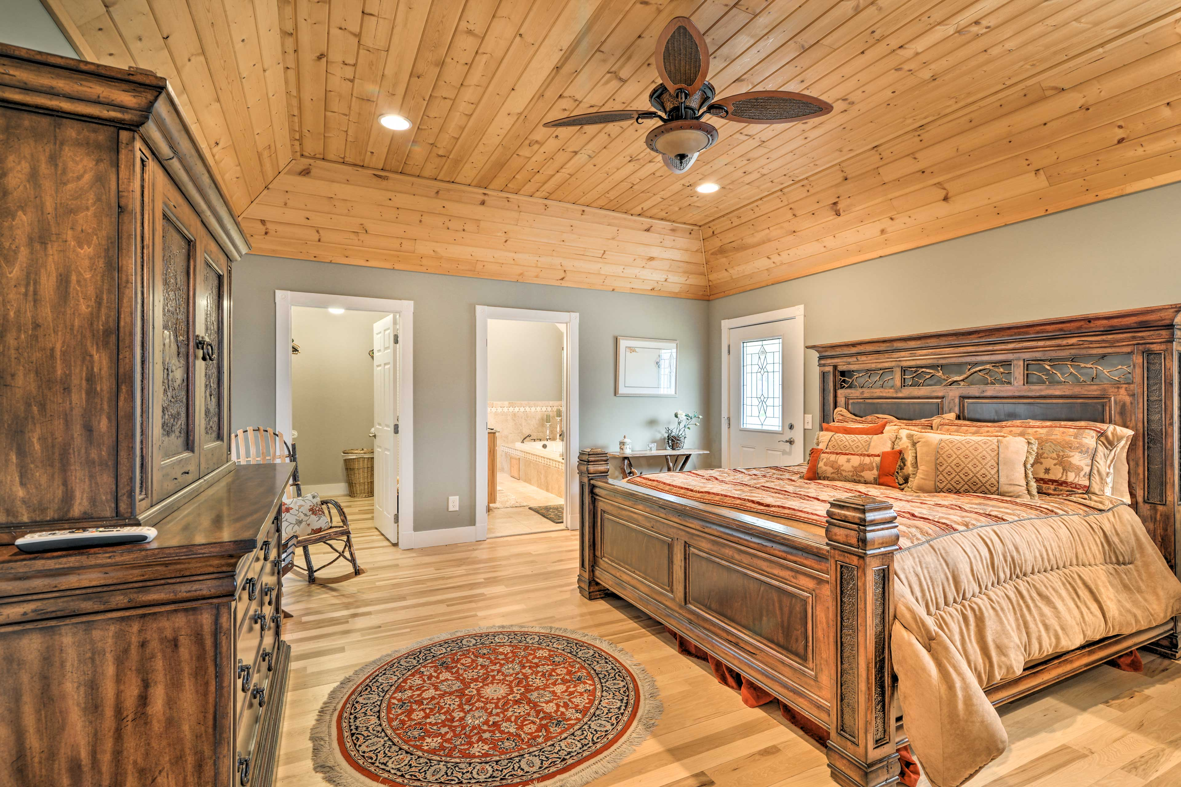 The master bedroom hosts a walk-in closet and private bathroom.