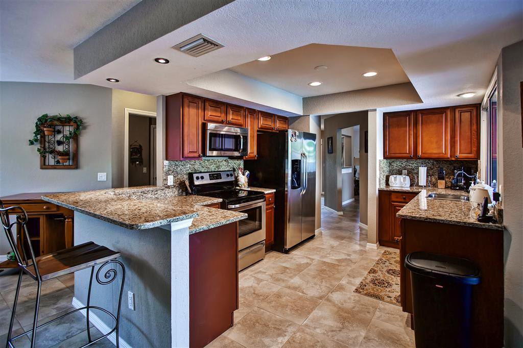 Prepare your favorite meals in this stunning fully equipped kitchen.