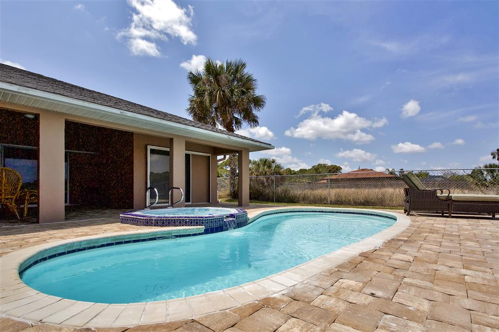 Soak up the Florida sun next to the heated pool!