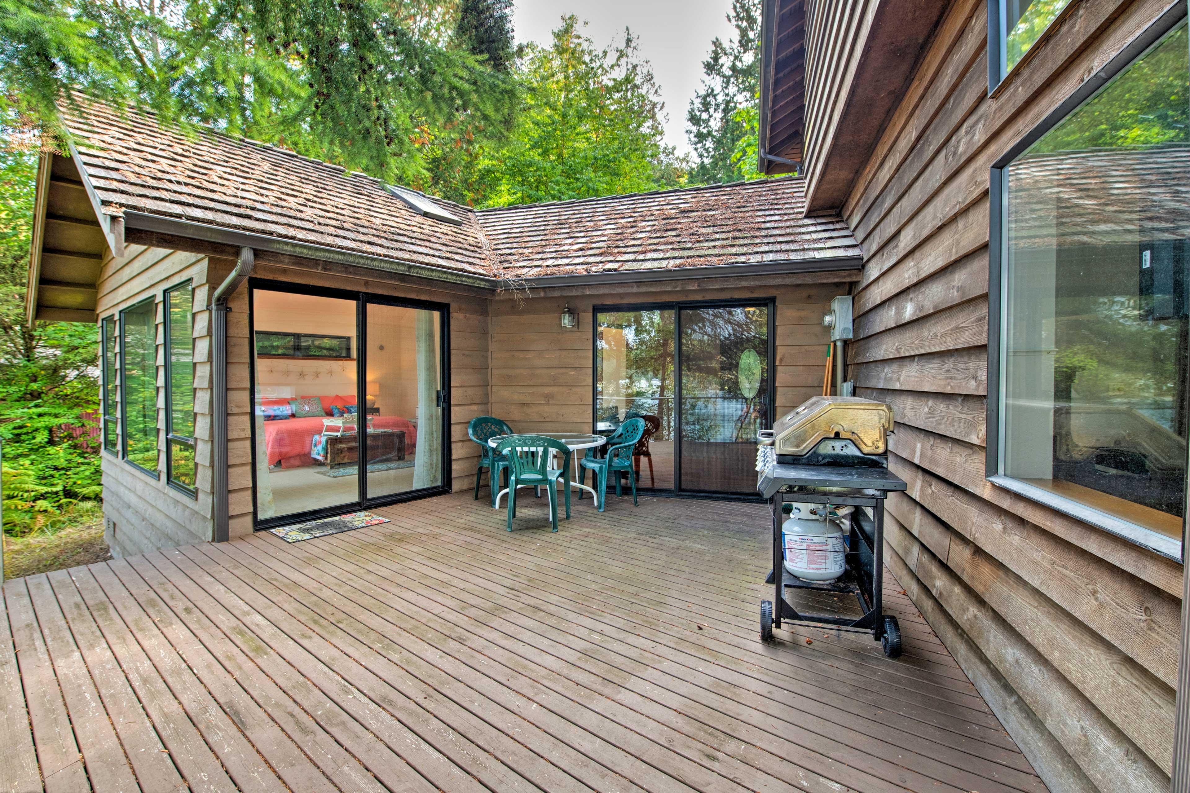 1st-Floor Wraparound Deck | Gas Grill | Dining Area