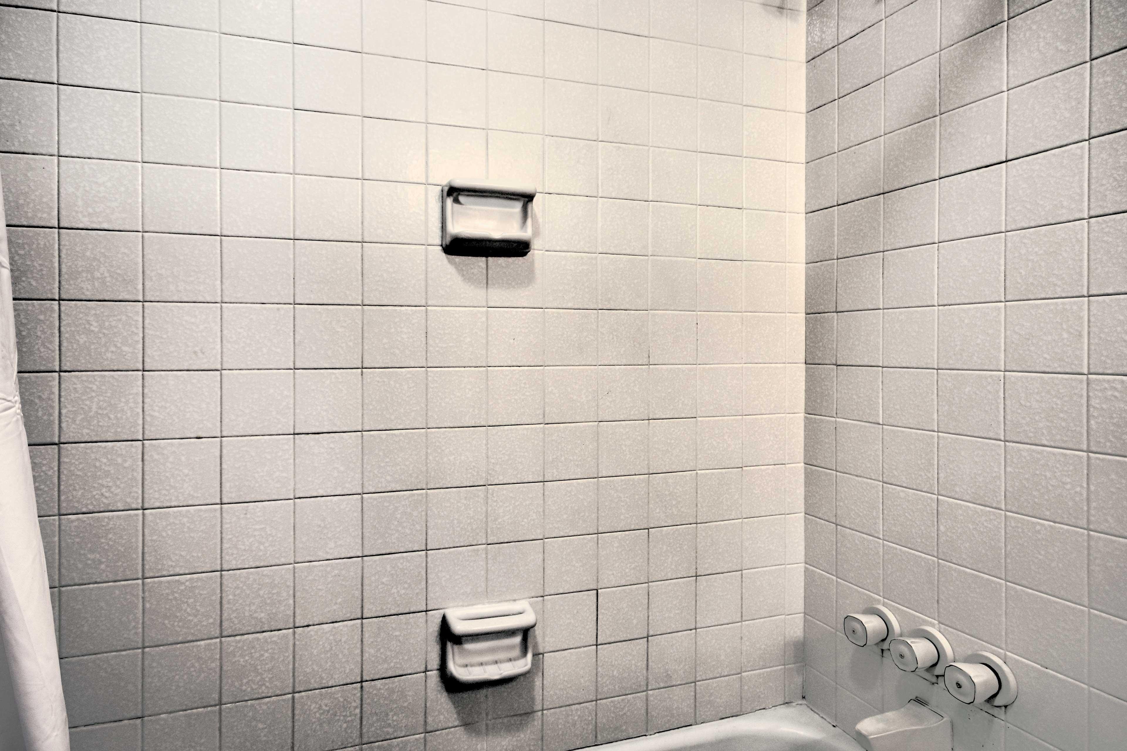 The second en-suite offers a shower/tub combo.