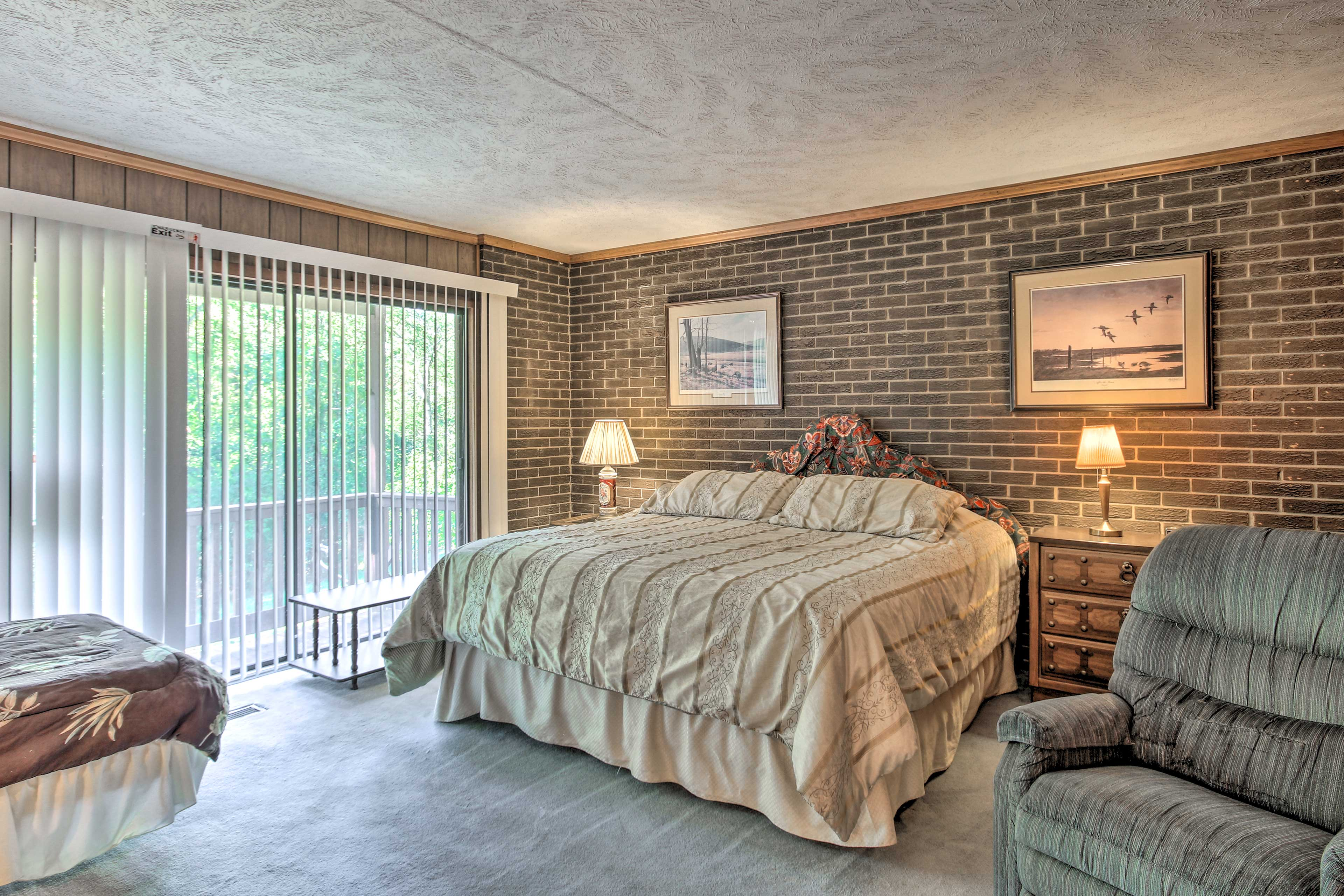 Lay back on the king-sized bed in the master bedroom.
