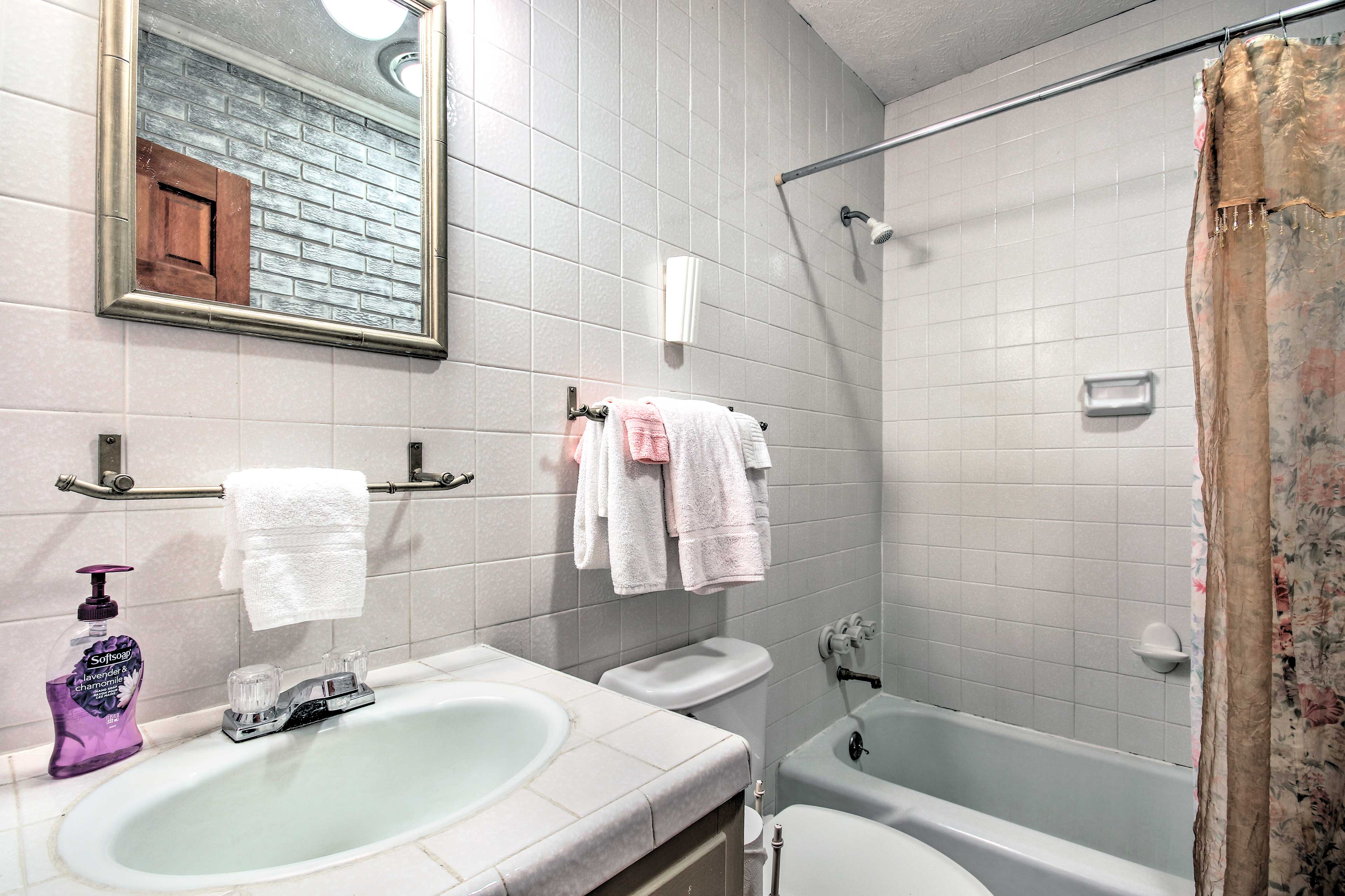 The final en-suite bathroom offers a shower/tub combo.
