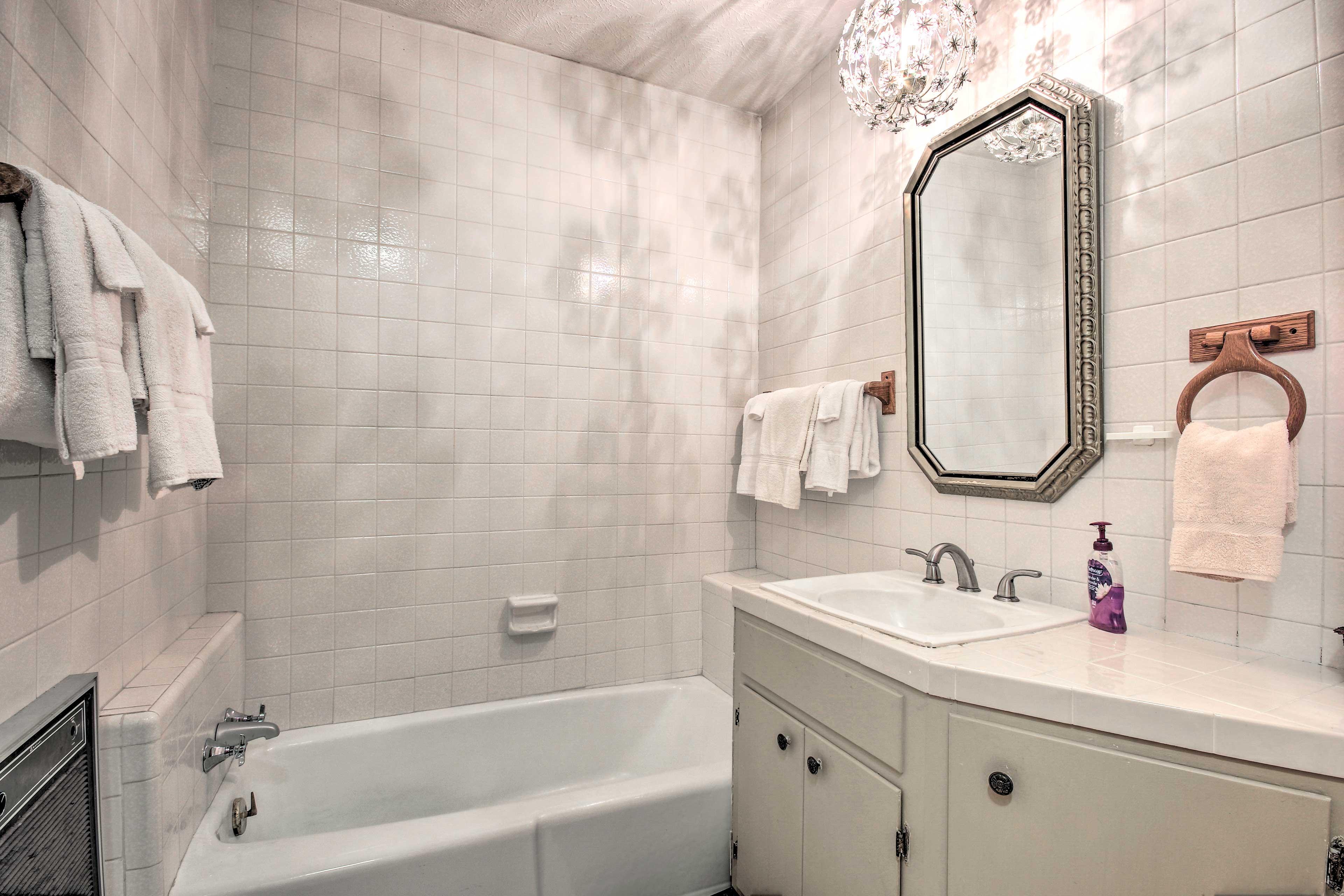 Soak in the tub before bed in the master en-suite bathroom.