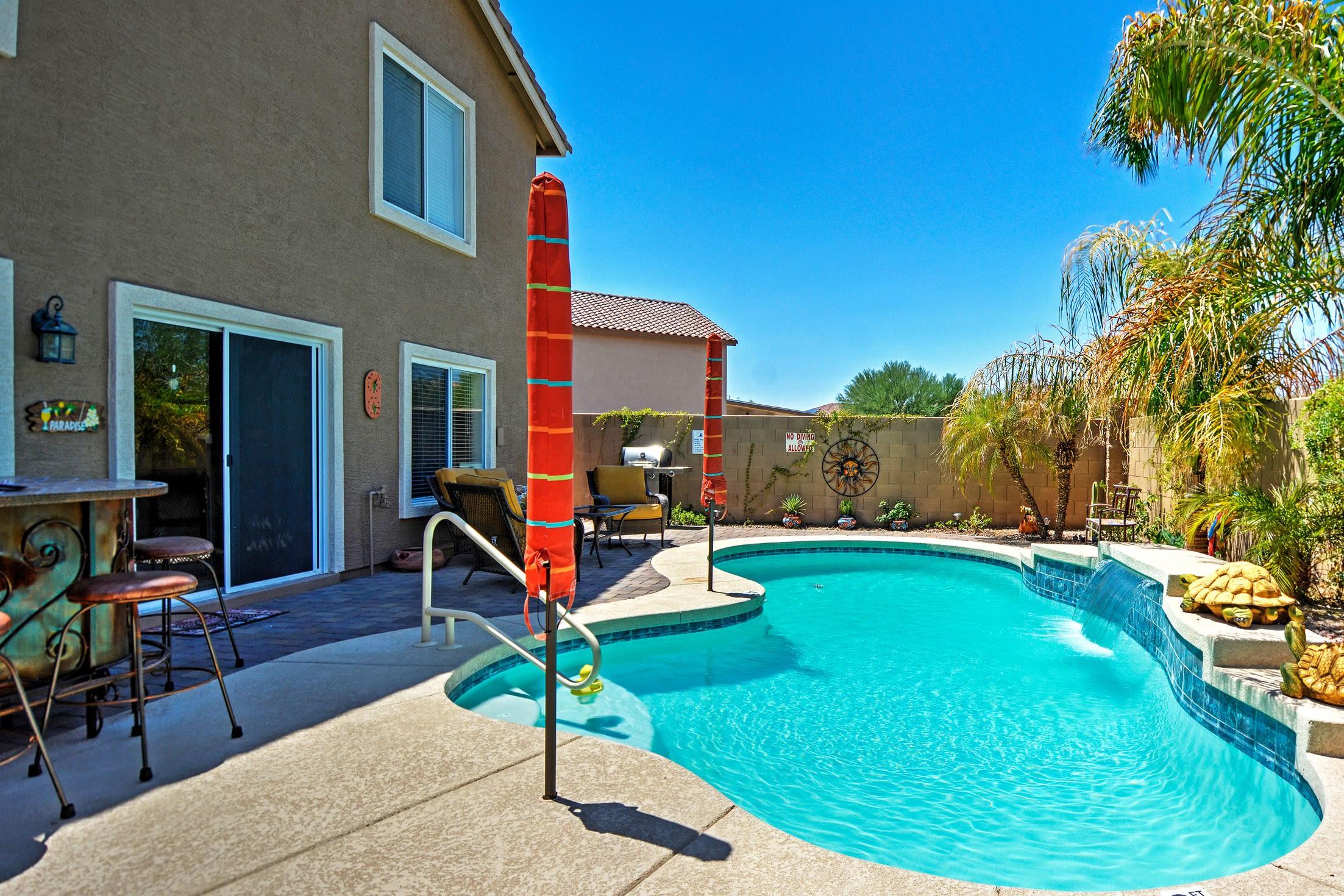 Enjoy a sunny getaway at this elegant Buckeye vacation rental home.