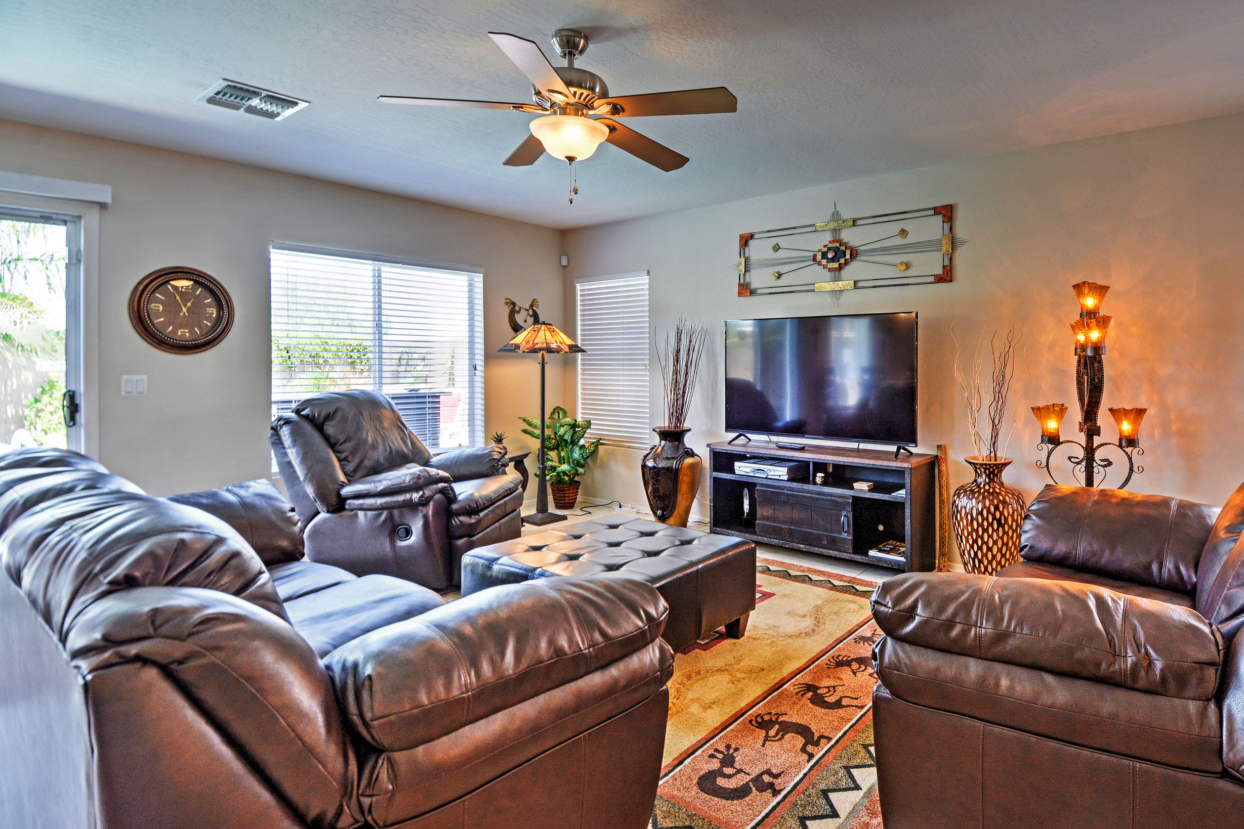 Watch your favorite movie on the flat-screen TV in the comforting living room.
