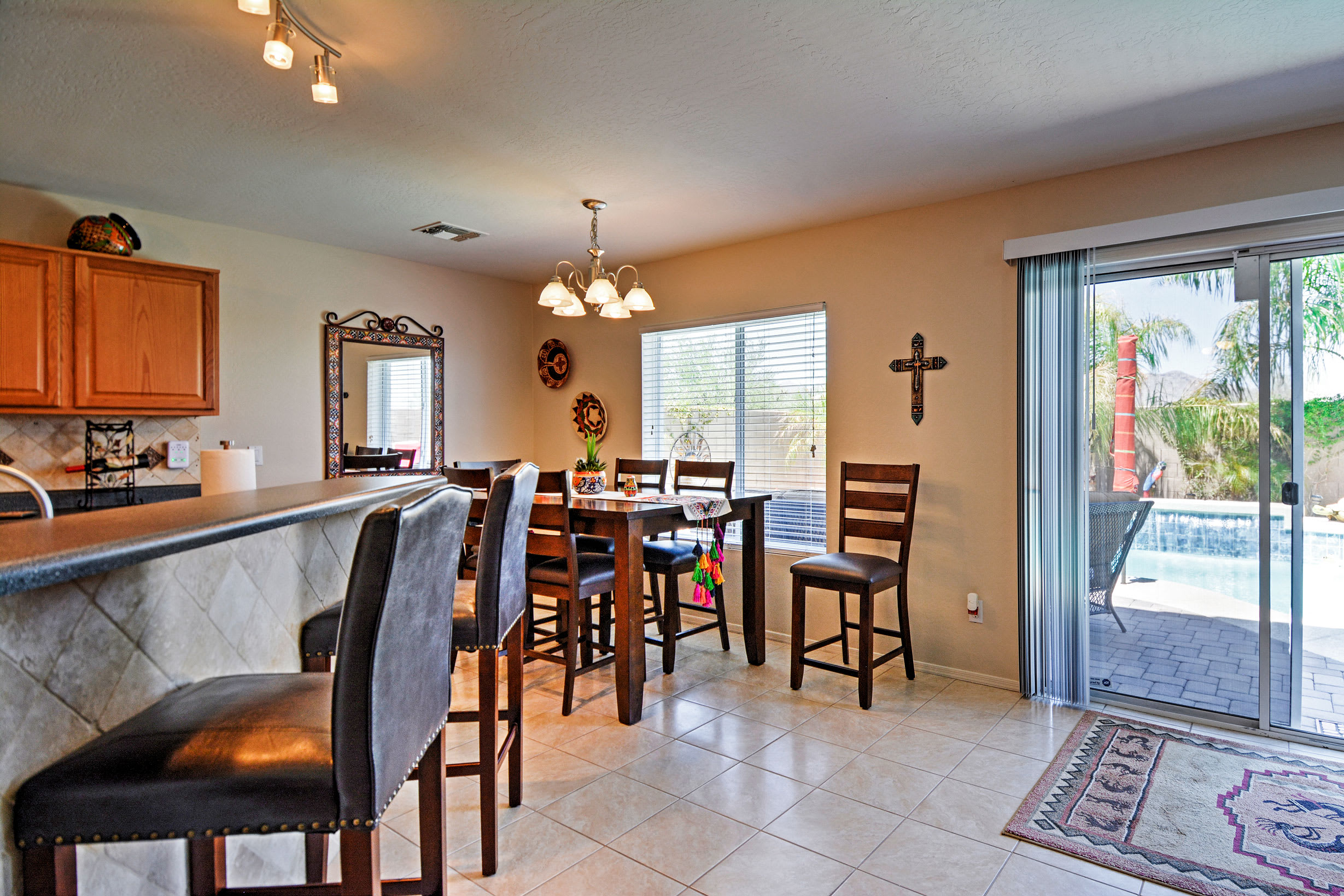 Stay connected at the breakfast bar or enjoy a family meal at the dining table.