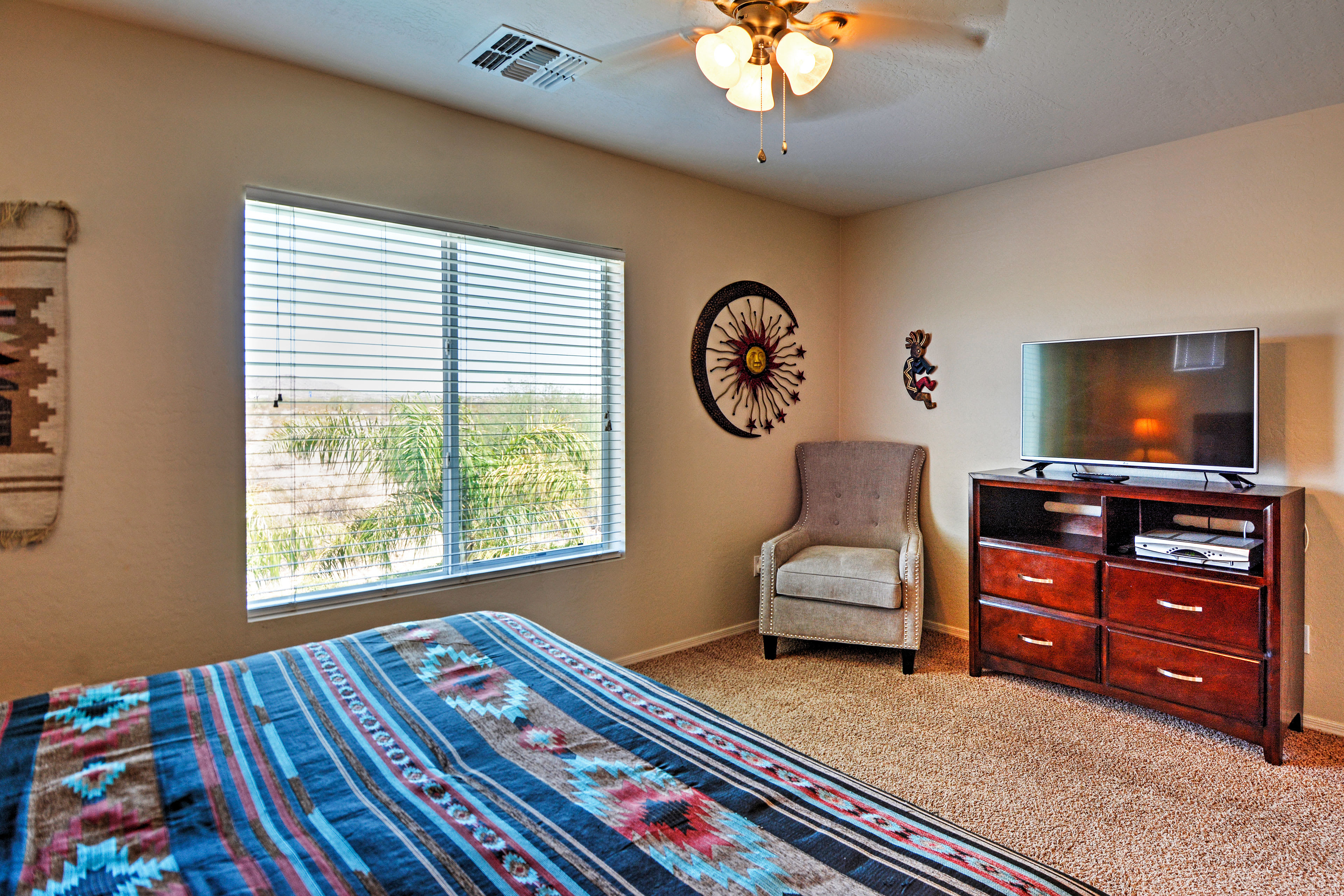 Rest peacefully in this southwestern bedroom.