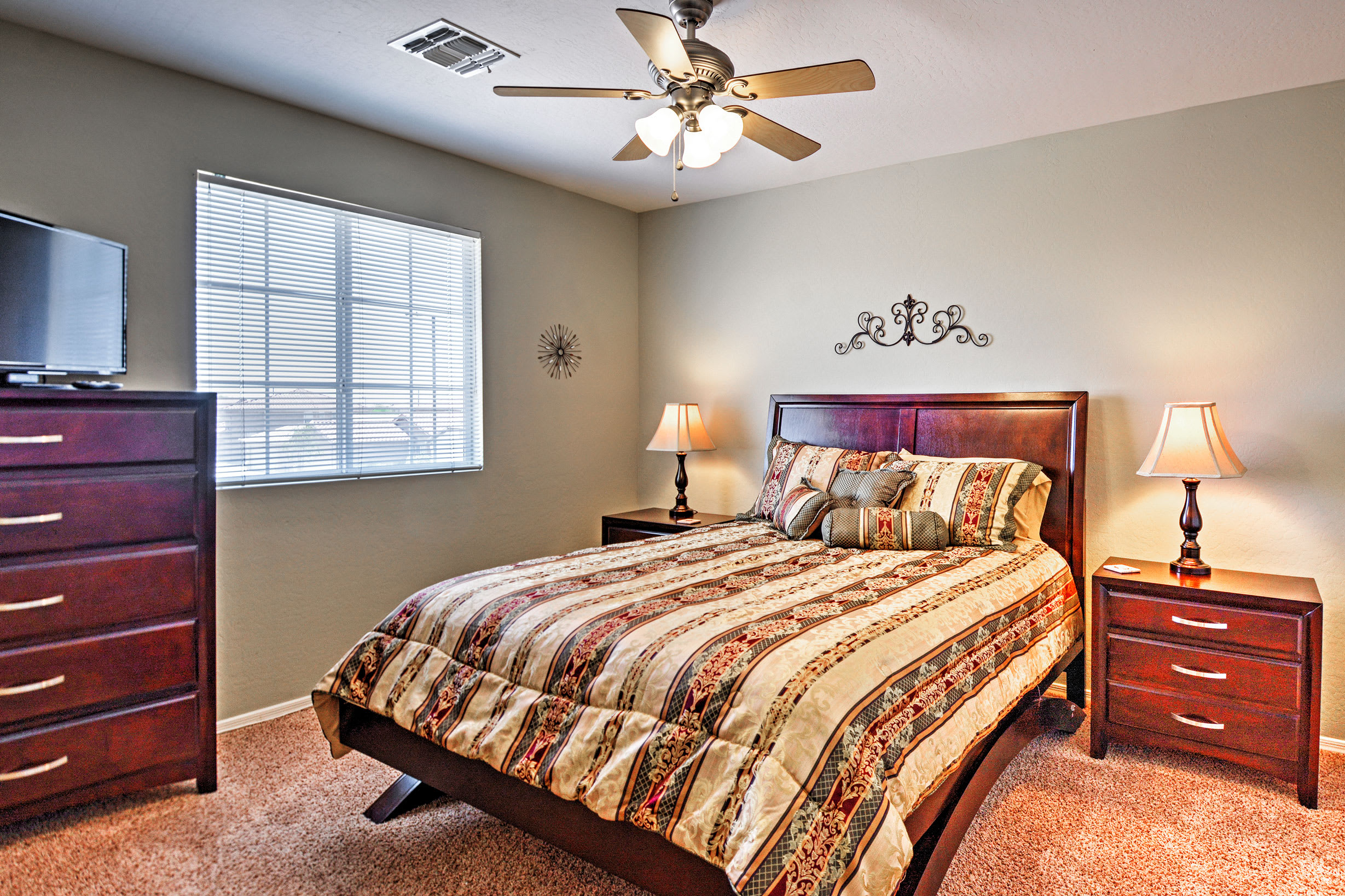 Cuddle up in this cozy queen-sized bed in the second bedroom.