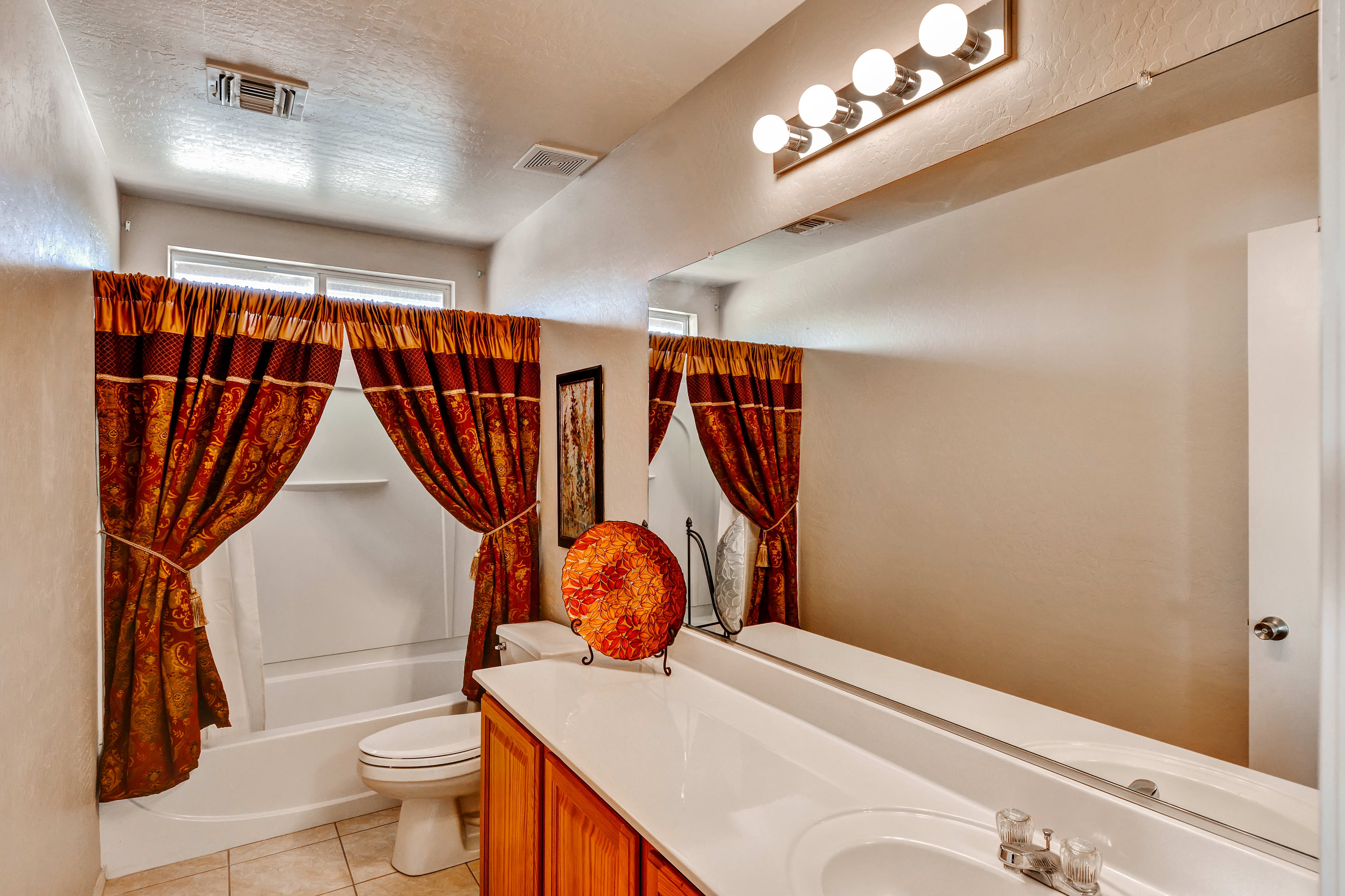 This elegant second bathroom lets you bathe like a queen.