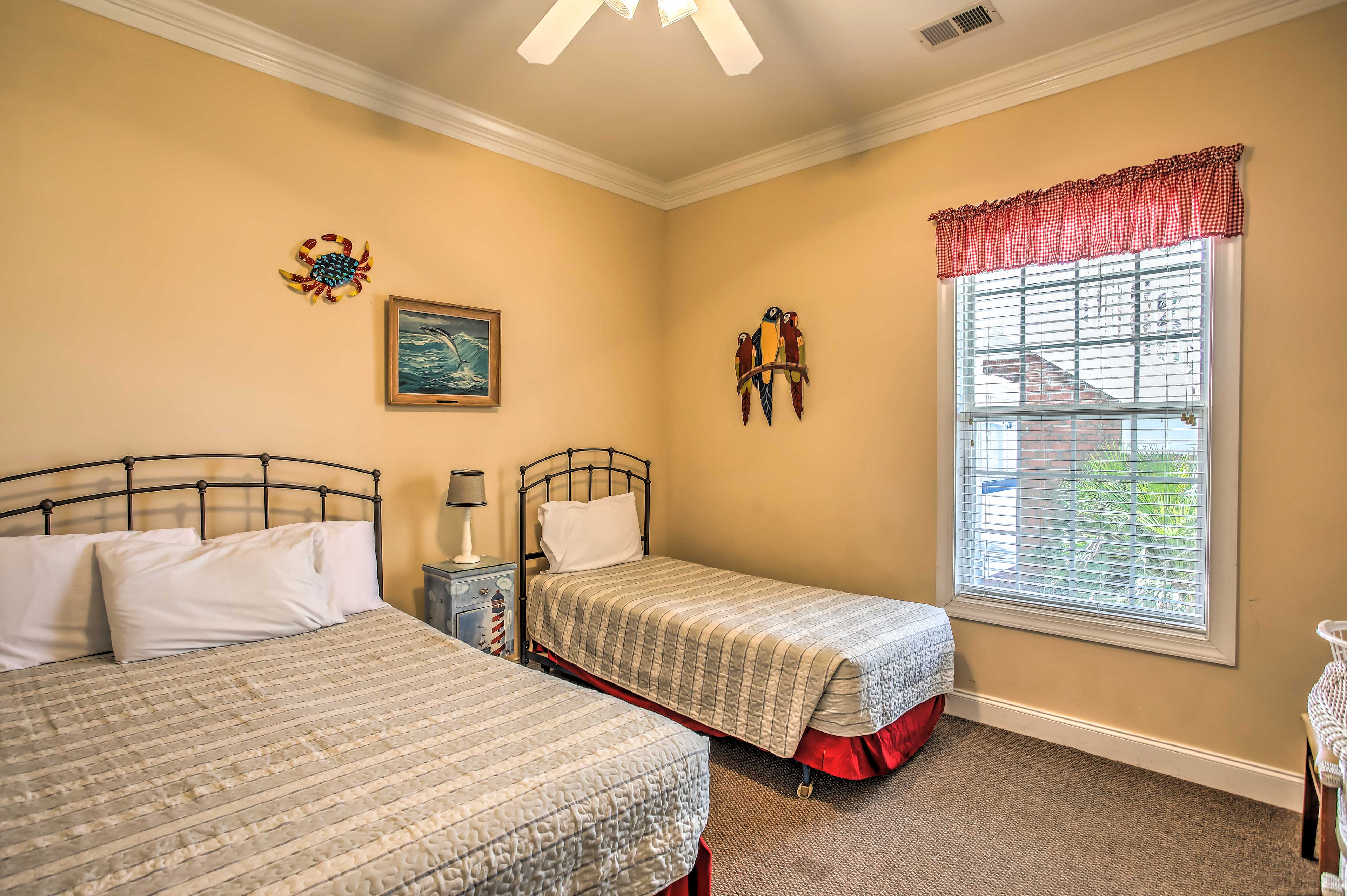 Kids will love sharing this room with a full bed and twin bed.