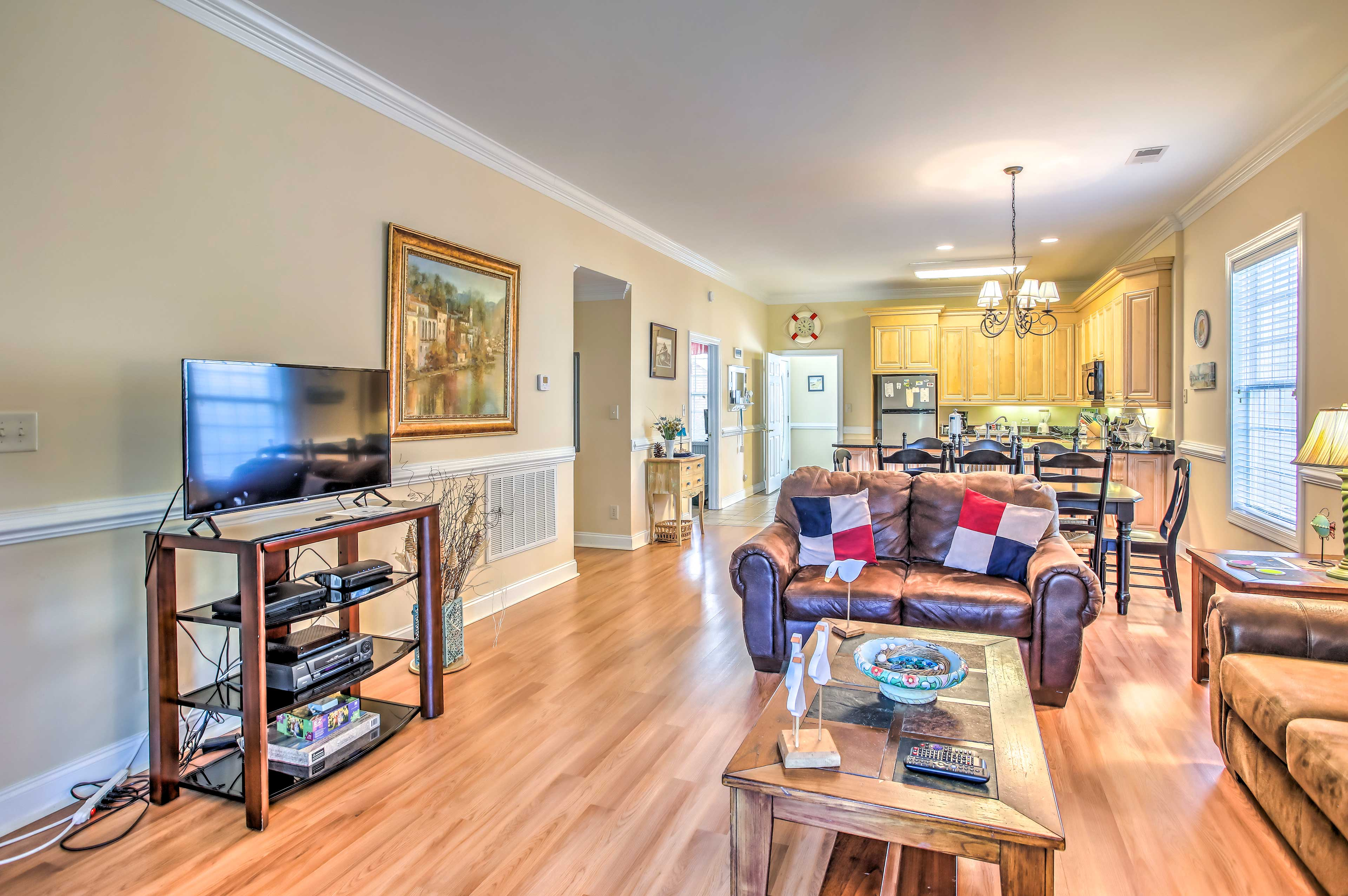 Hardwood floors and comfy furniture invites you into the space.