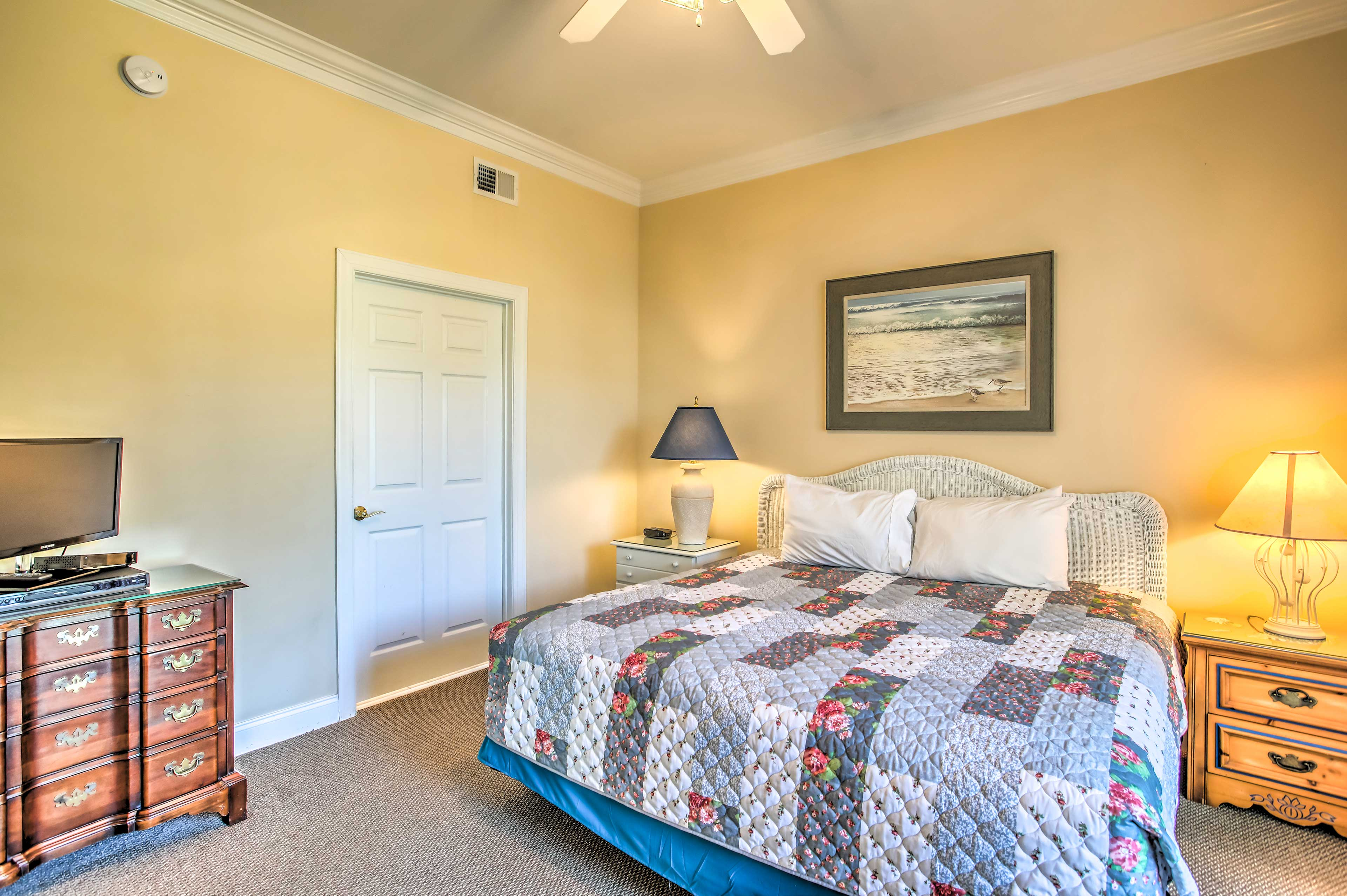 Sleep easily in the master bedroom's king bed.