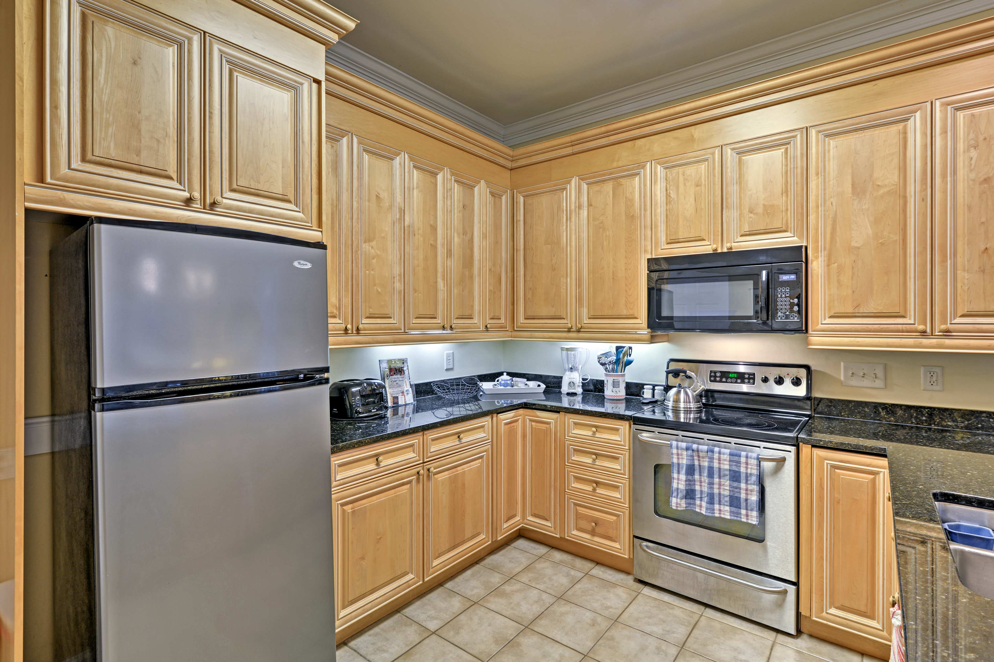 Prepare favorite recipes in the fully equipped kitchen featuring a dishwasher!