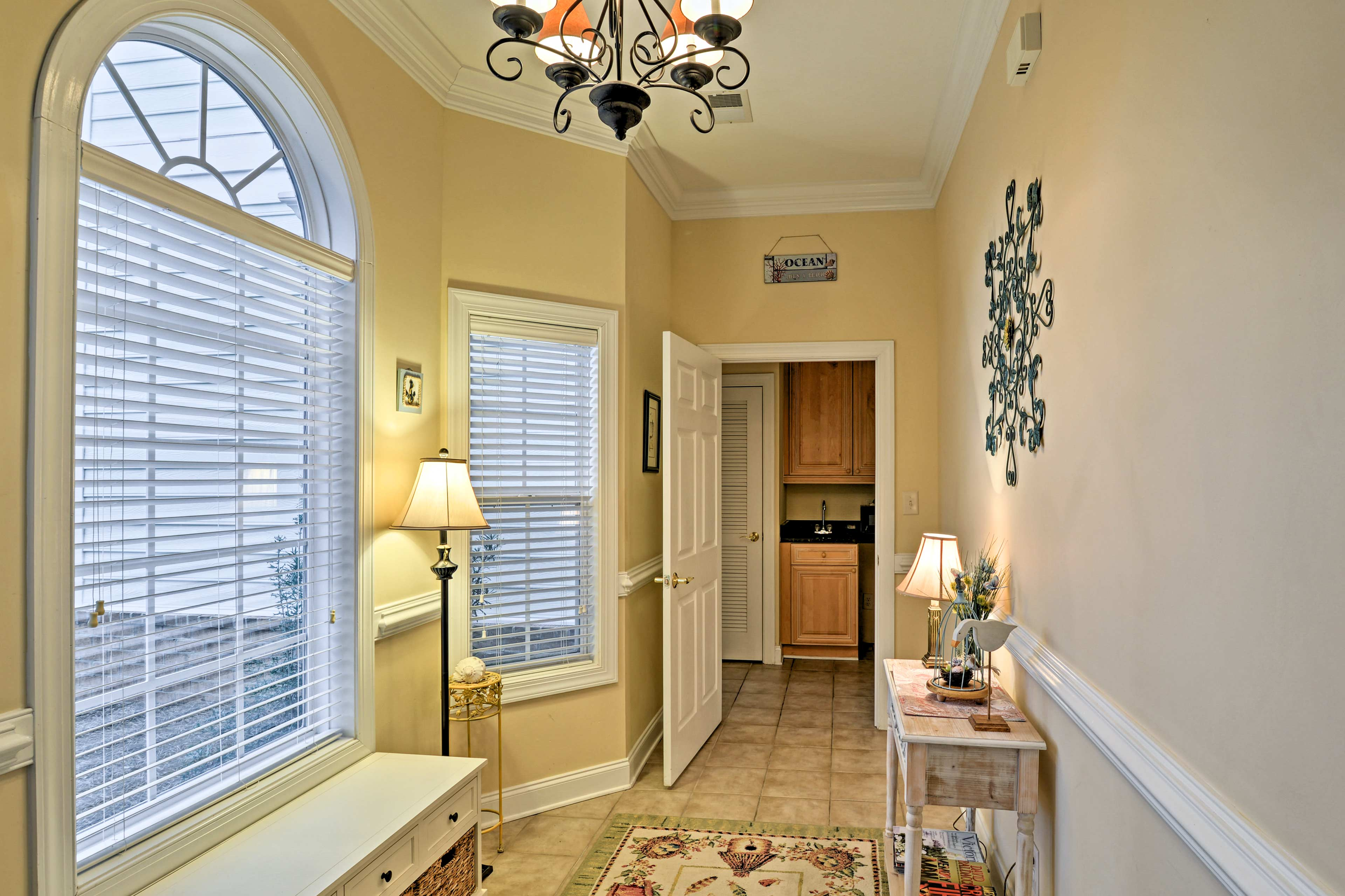 Ample sunlight shines through the windows, illuminating the foyer.