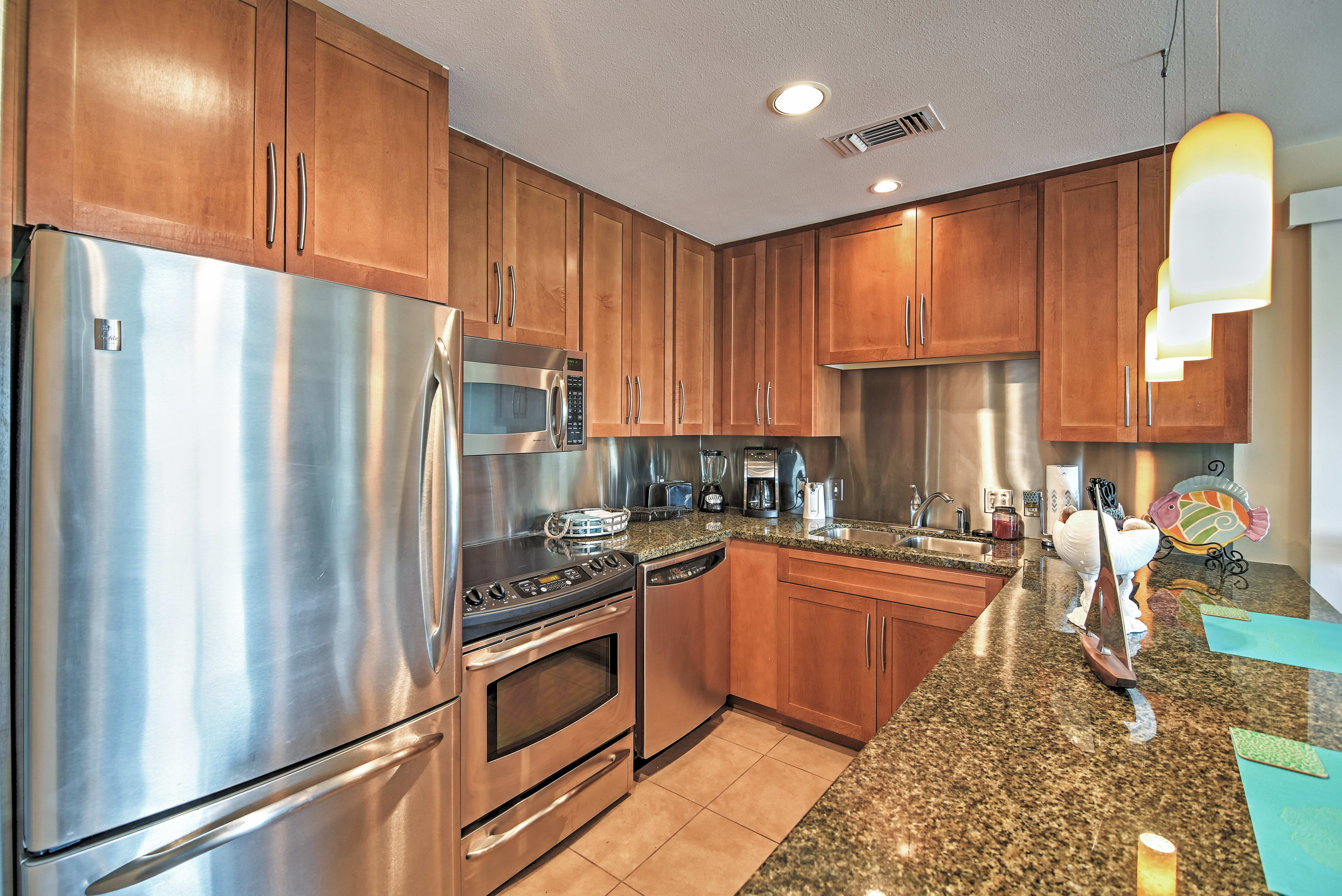 Prepare delicious home-cooked meals in the fully equipped gourmet kitchen.