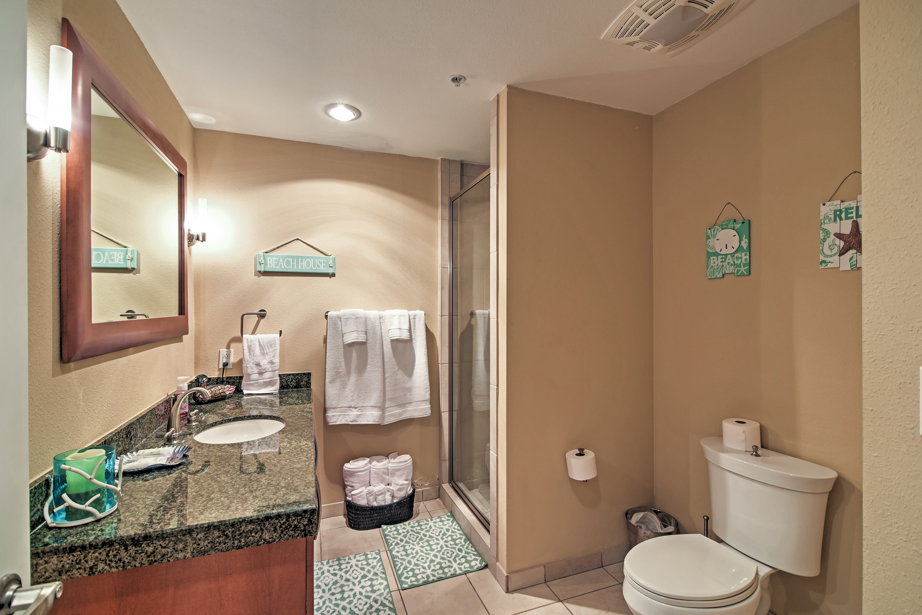 Enjoy a cleansing shower in this full bathroom after a day on the beach.
