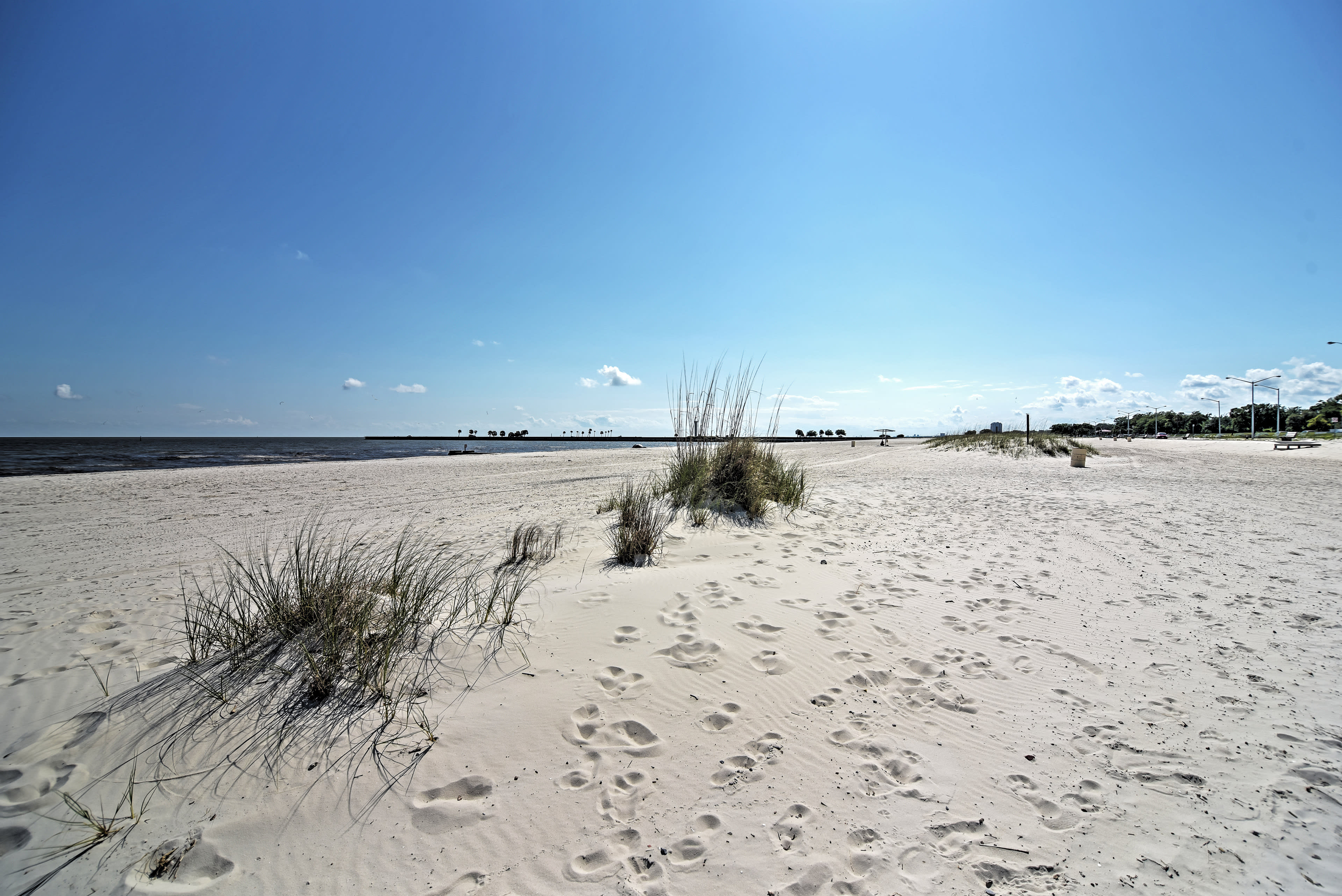 Only minutes from the beach, you'll have sand between your toes in no time!