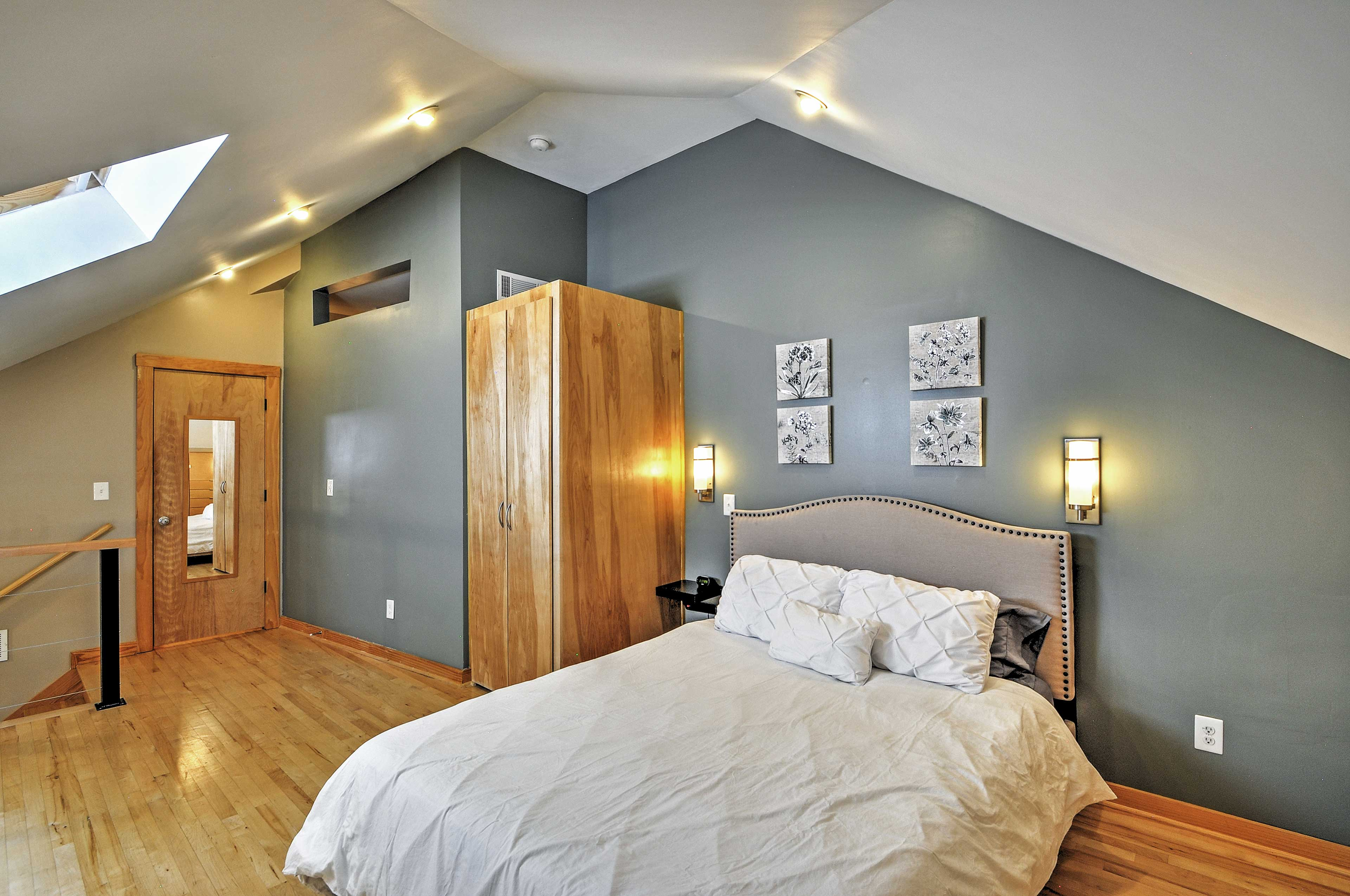 The loft features a cozy queen bed.