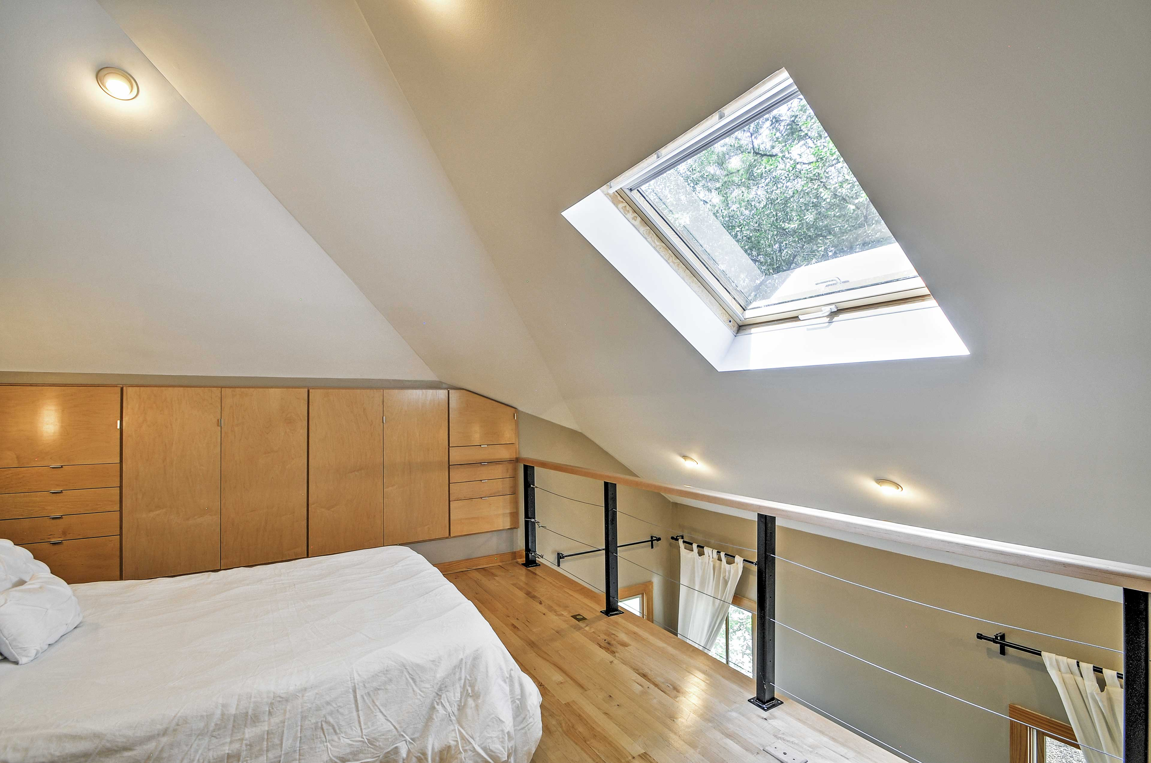 A skylight lets you gaze out at the bright stars right from your bed.