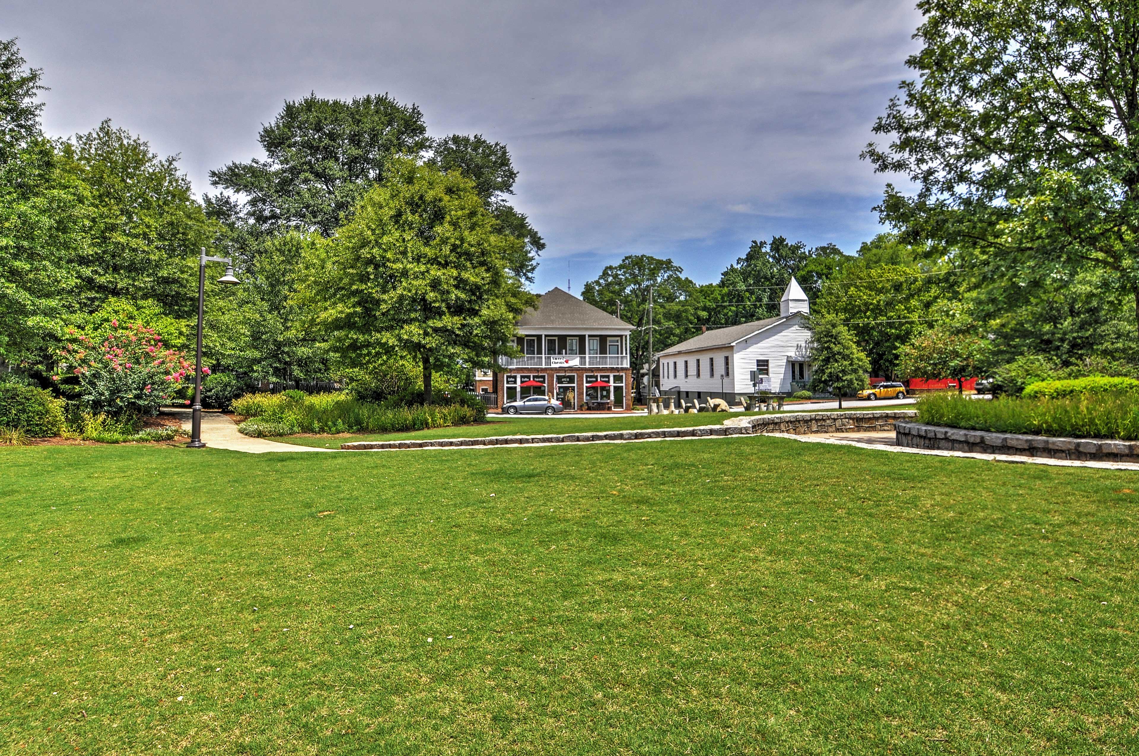 Vibrant landscape surrounds the property.