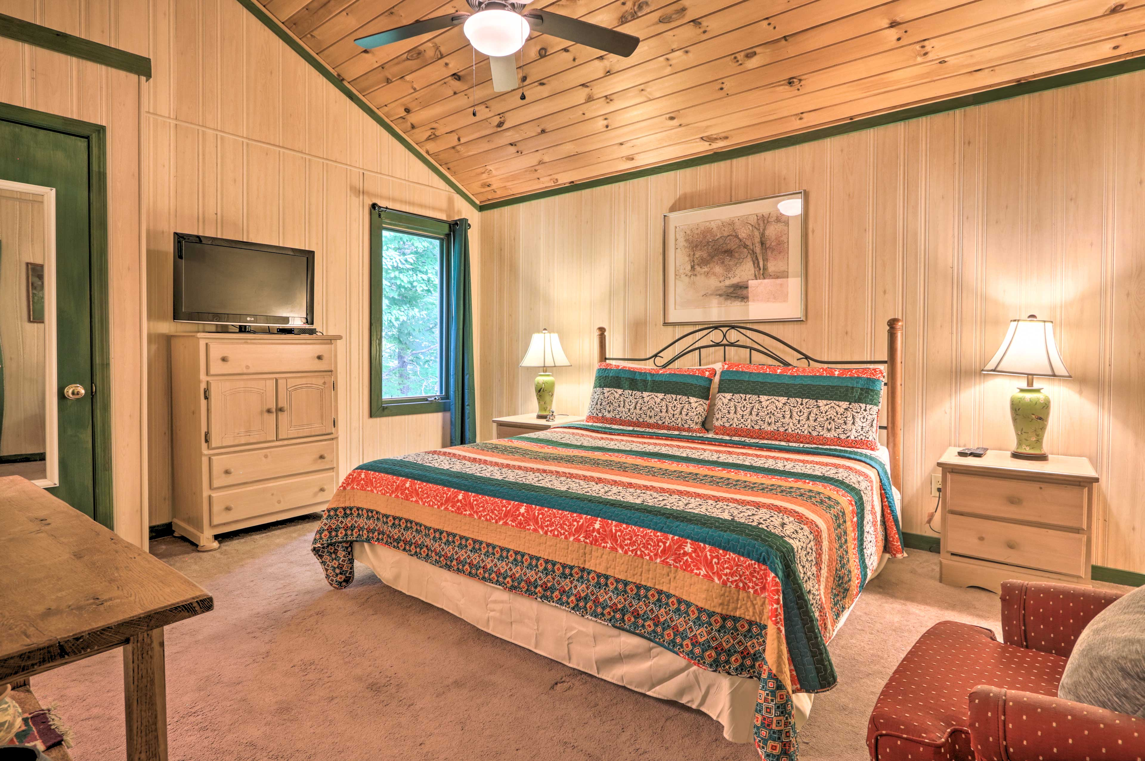 Take a load off in the lovely master bedroom.
