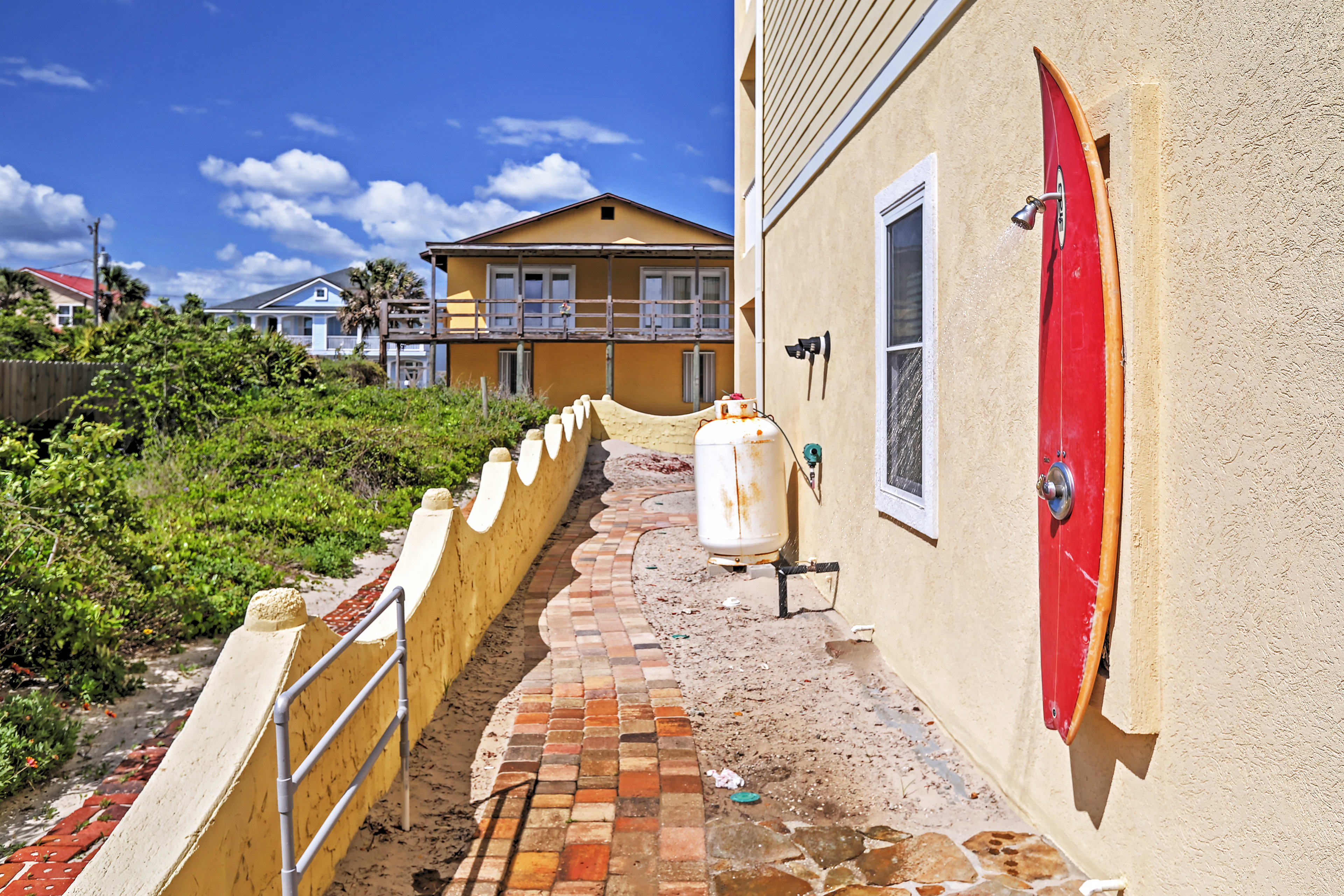Shower off the sand from your day at the beach under this unique outdoor shower!
