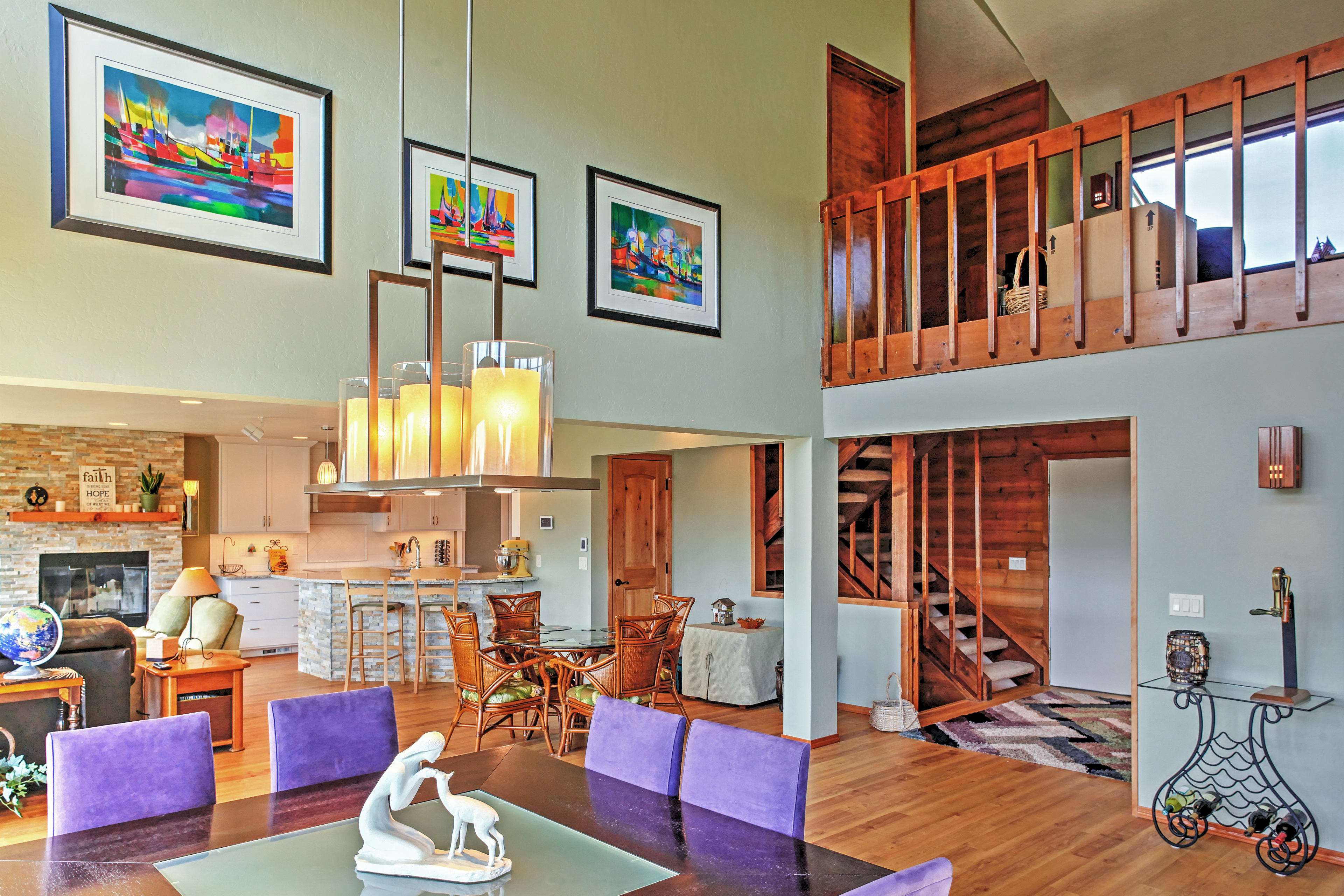 A spacious loft overlooks large formal dining room.