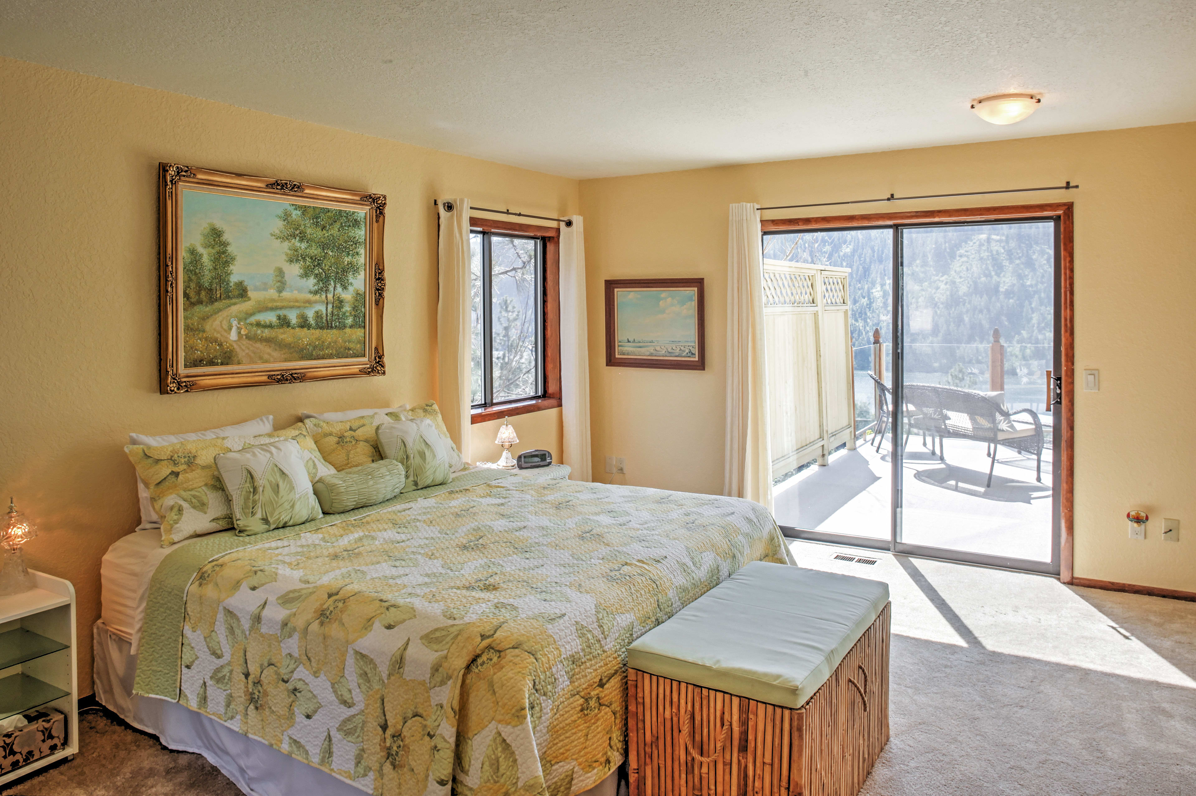 The master suite includes a plush king bed and private deck access.