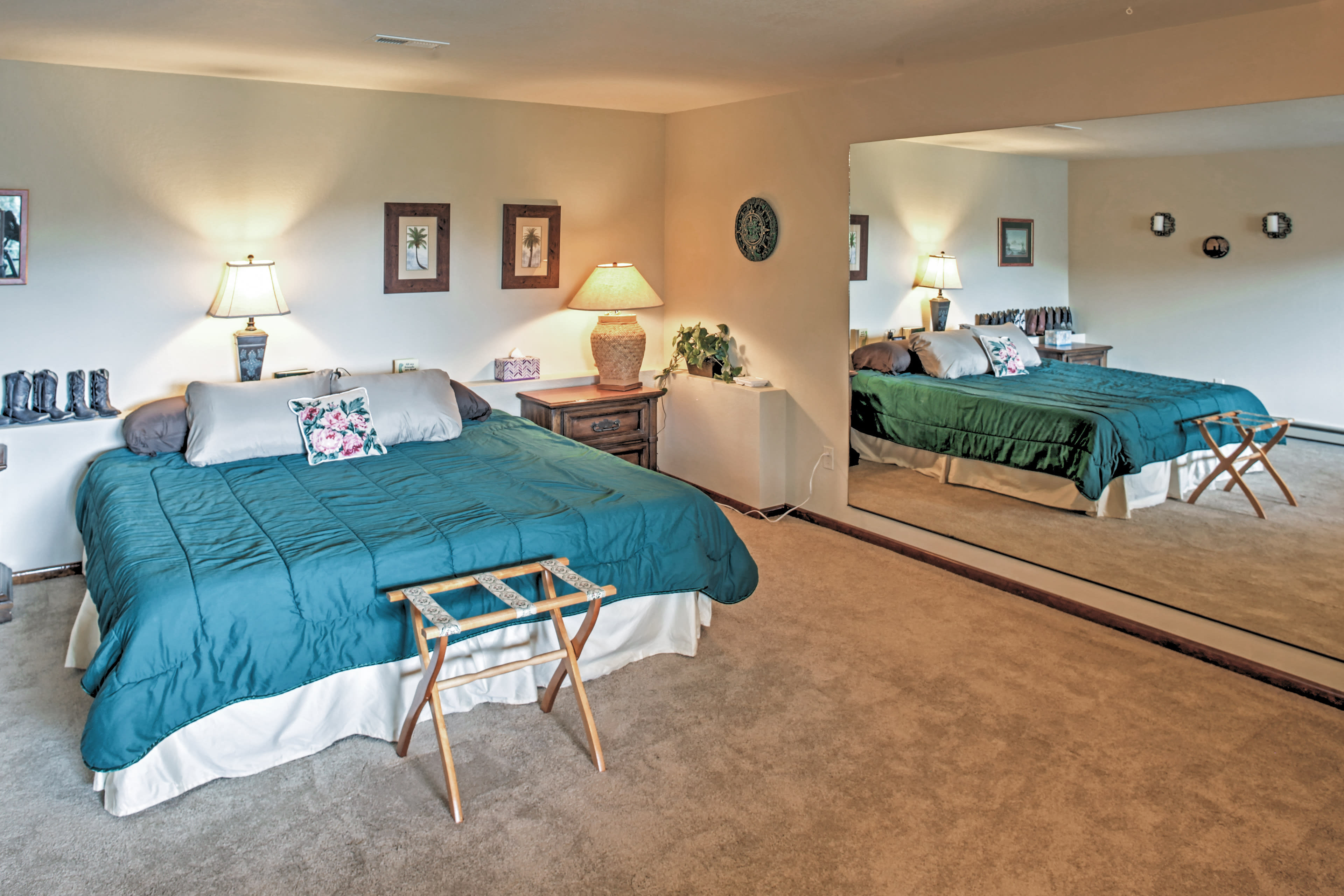 Yet another huge bedroom has a king size bed, lake views and a massive mirror.