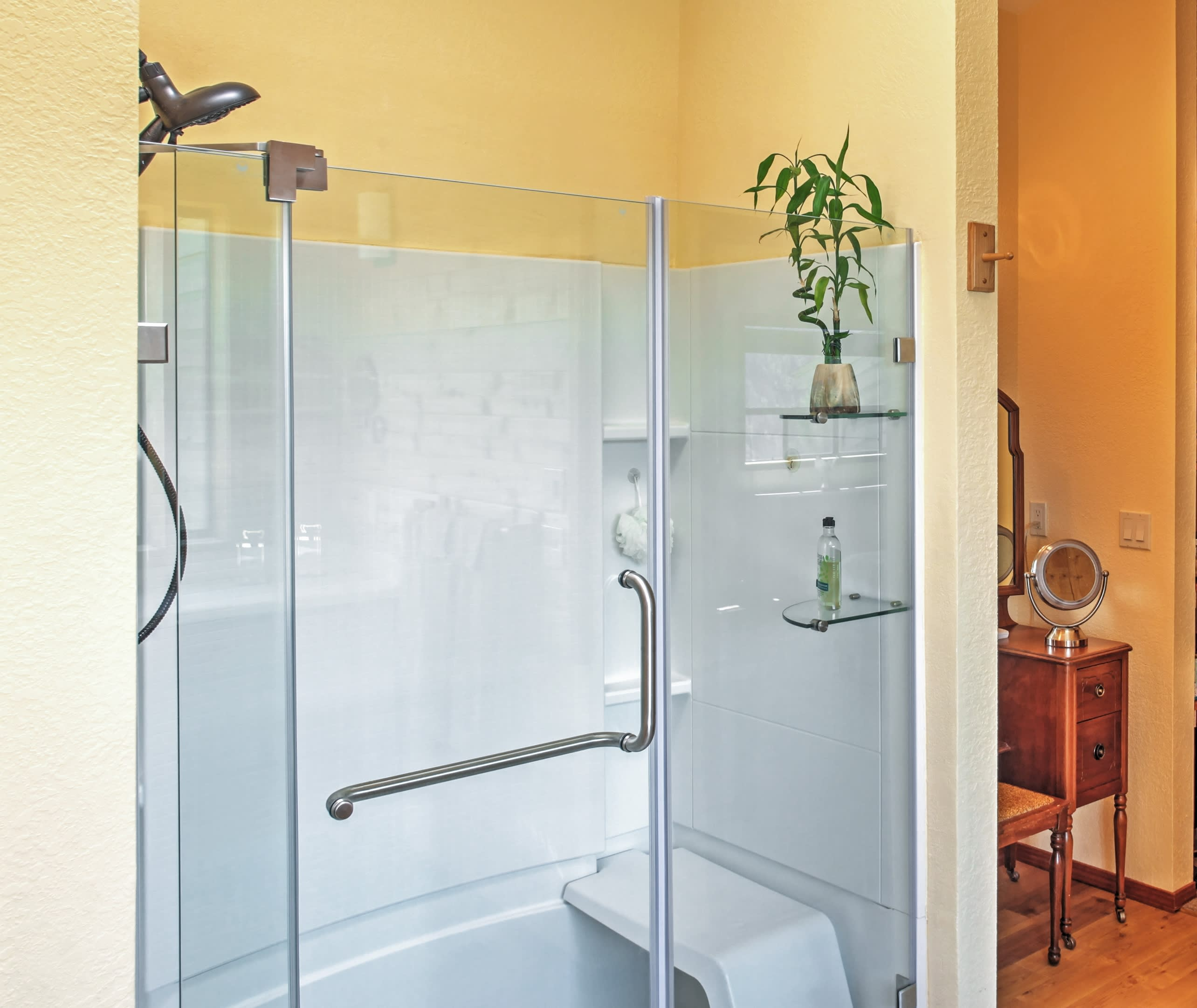 Capture the view from the roomy walk-in shower.
