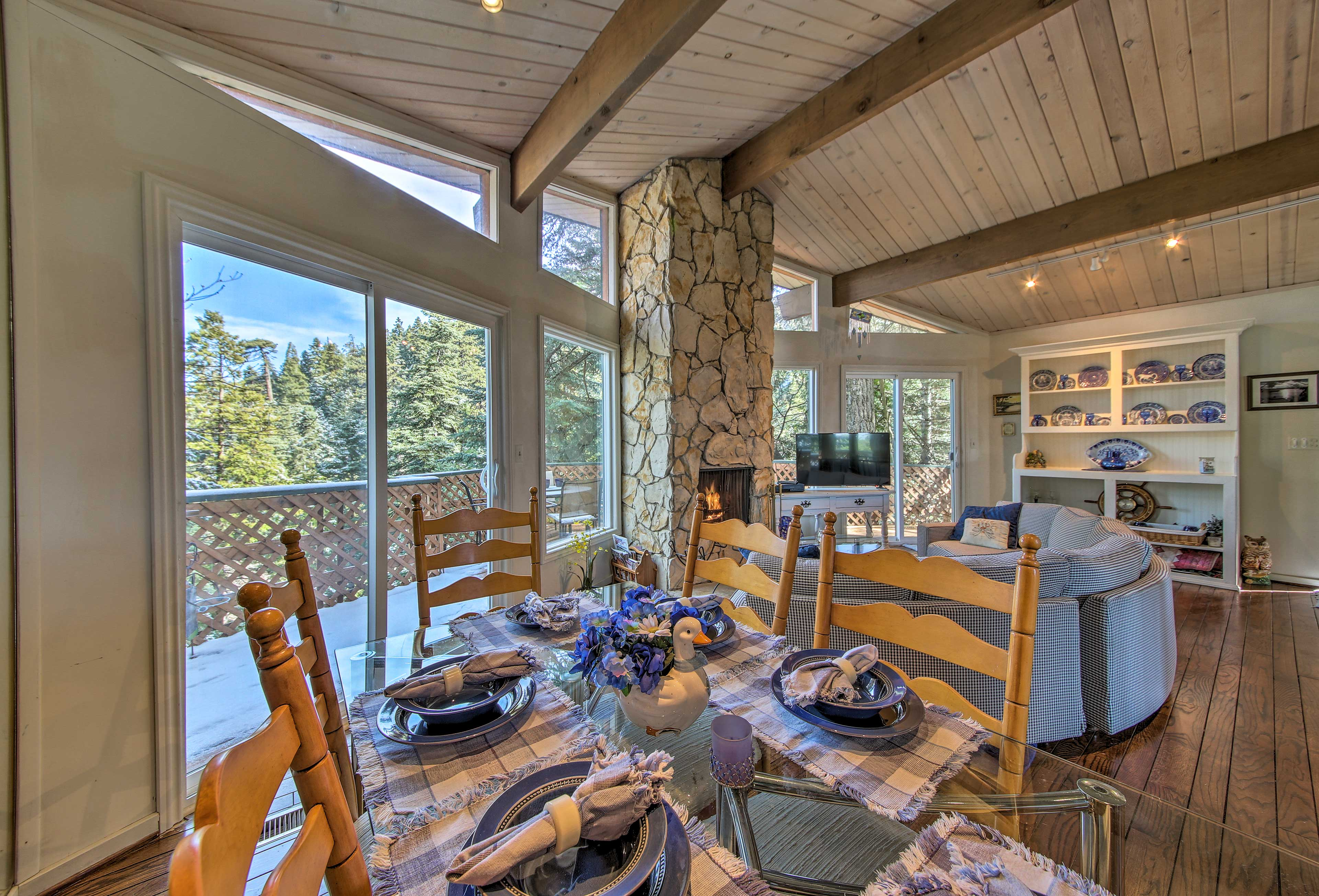 Share home-cooked meals at this beautiful dining table facing the forest views.