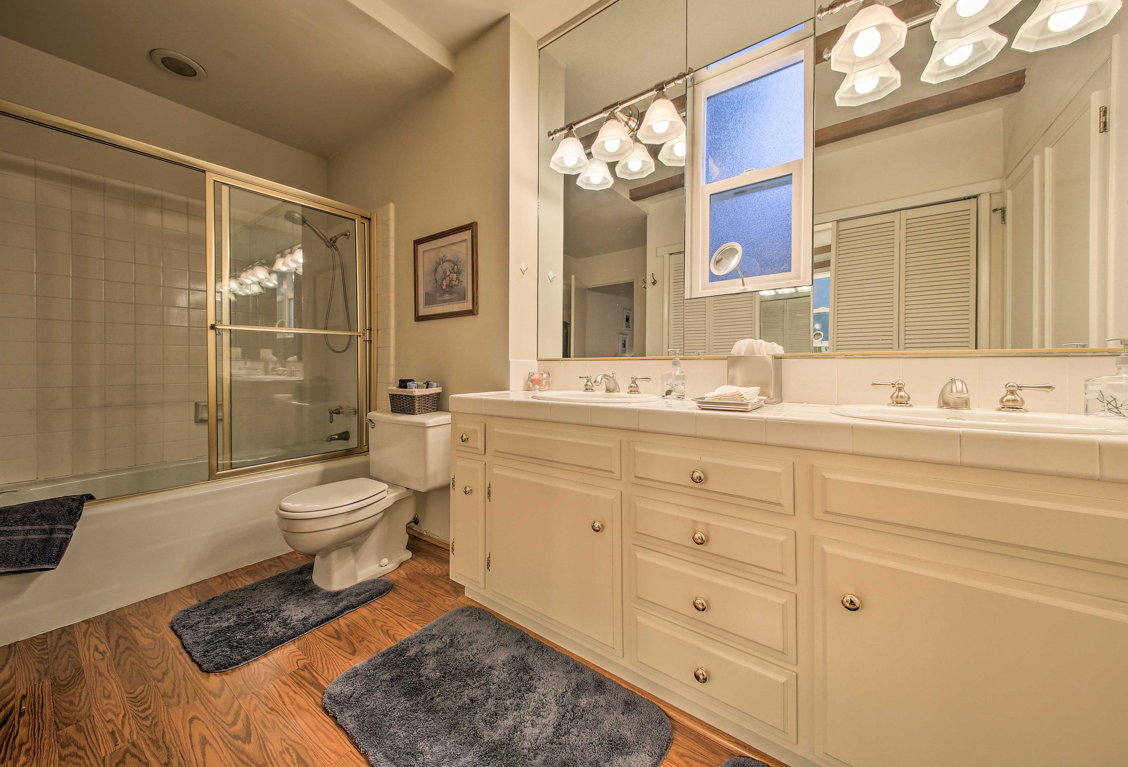 The bathroom includes a shower/tub combo and double sinks.