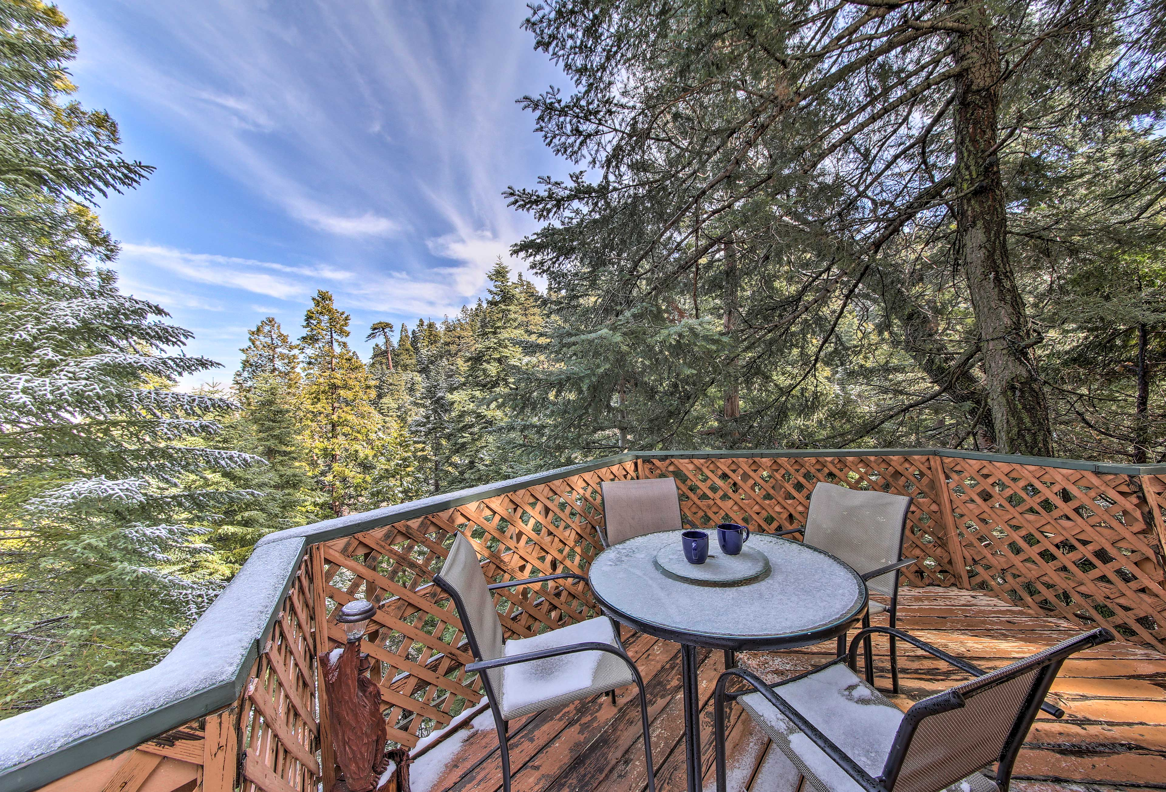 Up to 8 travelers will enjoy scenic forest views from the outdoor deck.